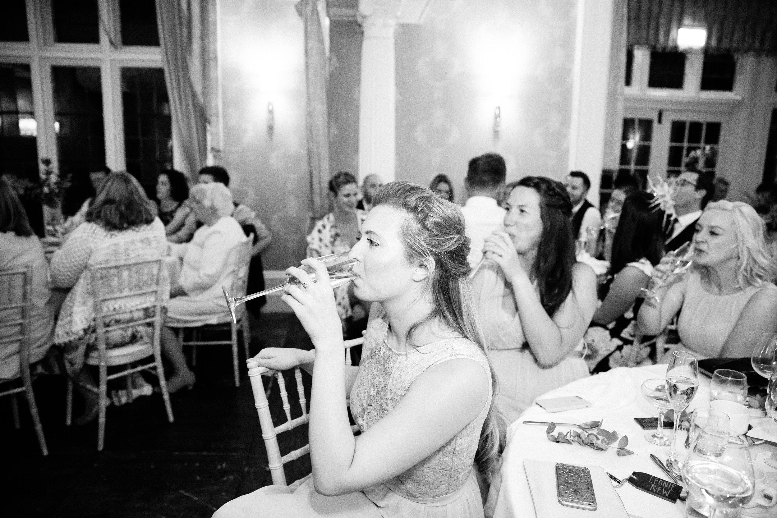 Bridesmaid drinkign champagne toast at Falcon Manor Wedding Photographer Yorkshire