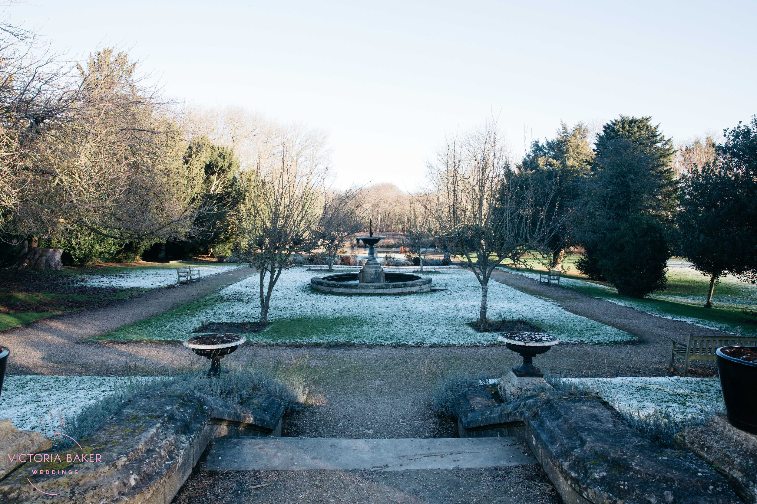 Monk Fryston Hall Gardens in snow | Wedding photographer Leeds