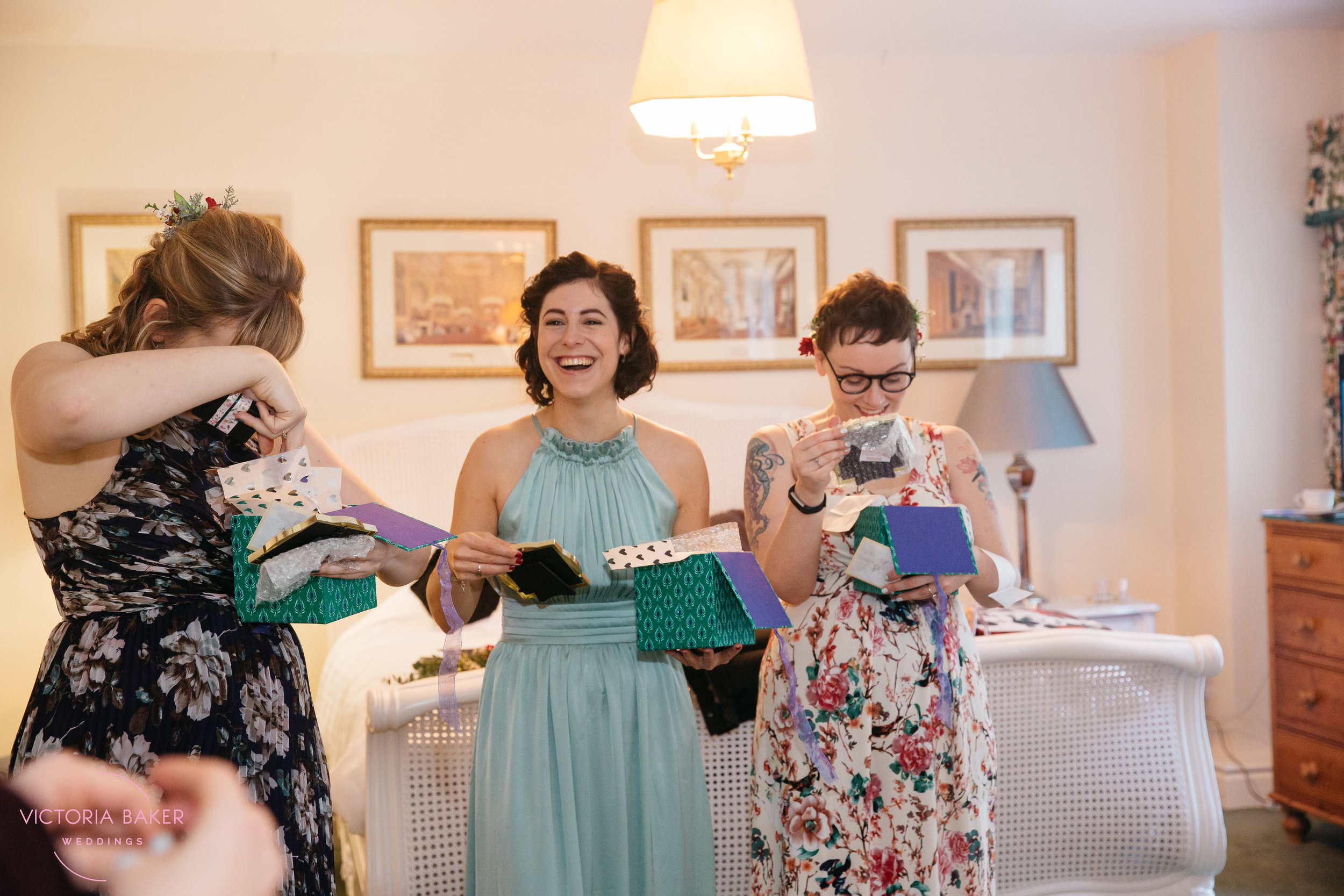 Bridesmaids getting gifts at Monk Fryston Hall | Wedding photographer Leeds
