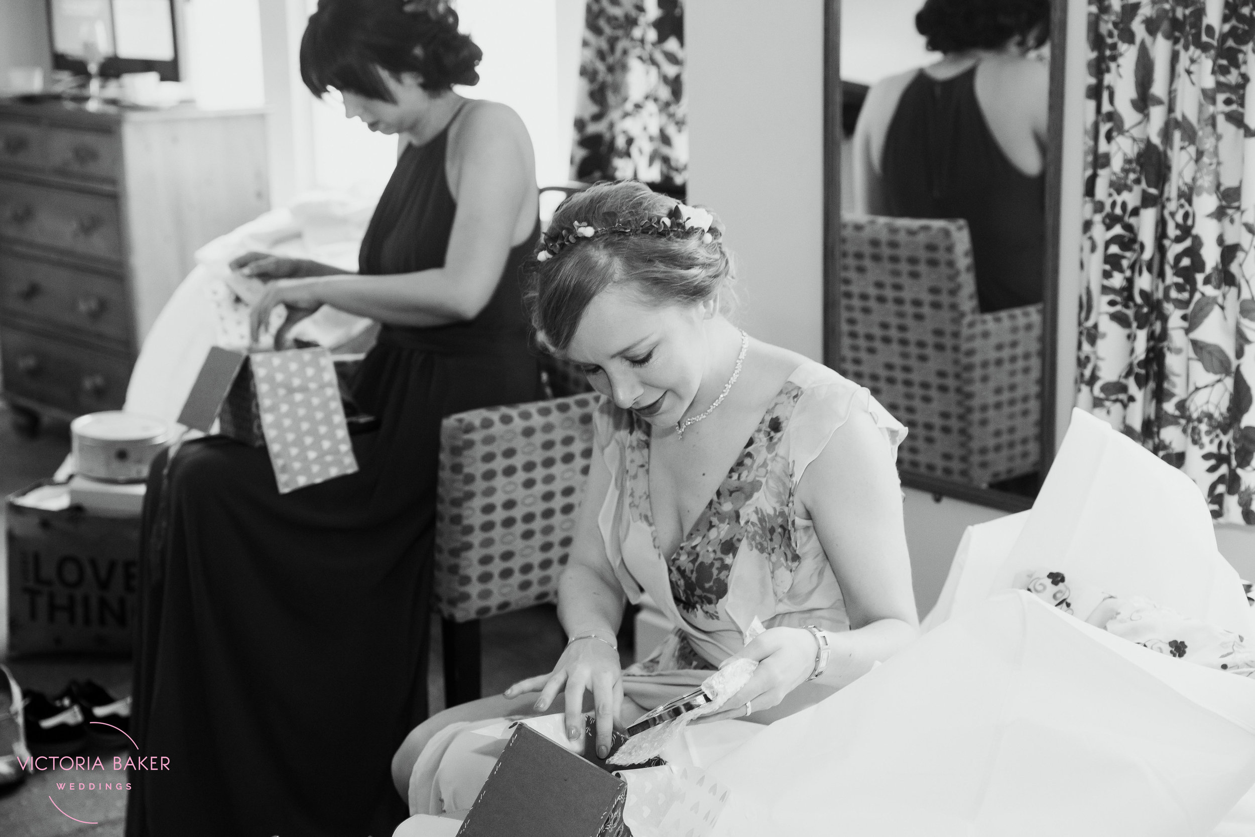Bridesmaid opening gift at Monk Fryston Hall | Wedding photographer Leeds