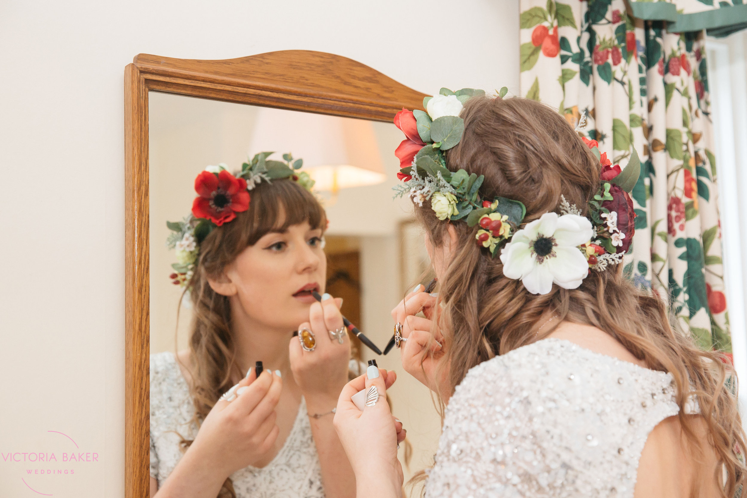Bride finishing make up at Monk Fryston Hall | Wedding photographer Leeds