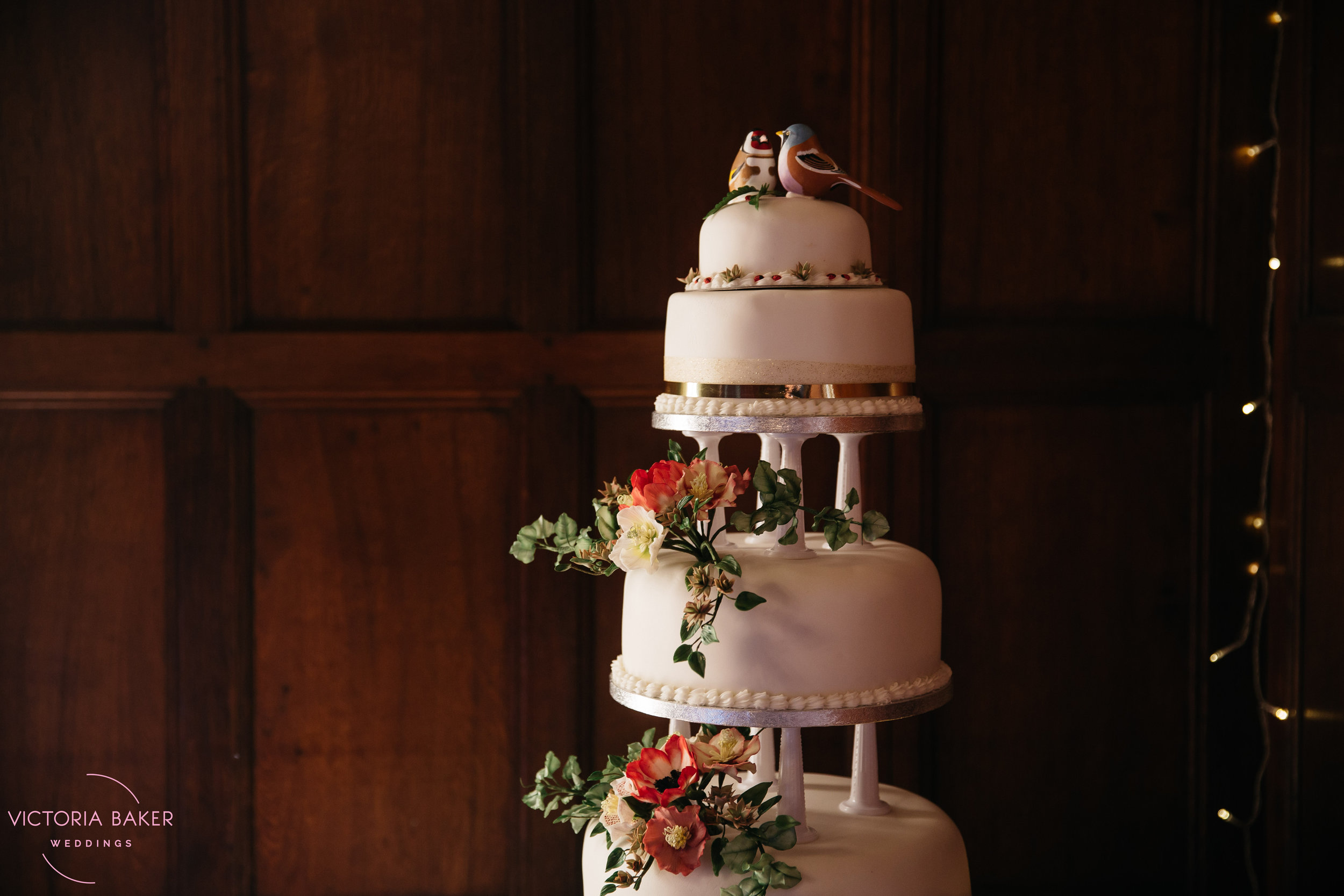 Wedding Cake with flowers at Monk Fryston Hall Leeds Wedding Photographer