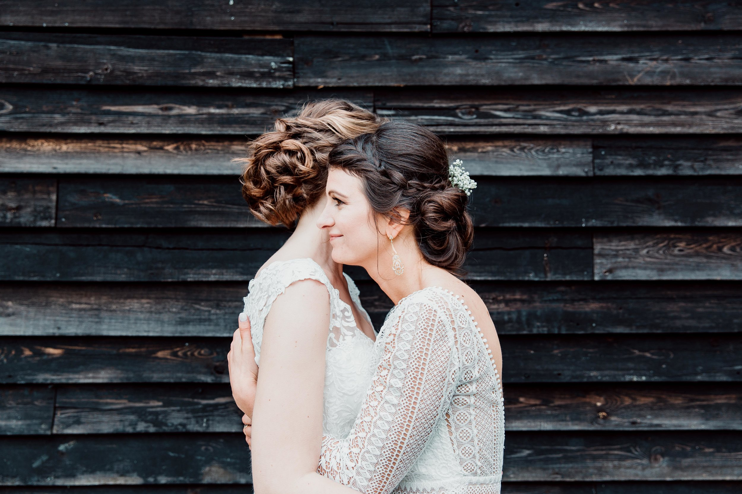 Vanessa & Hannah hugging - Chilterns wedding Winery