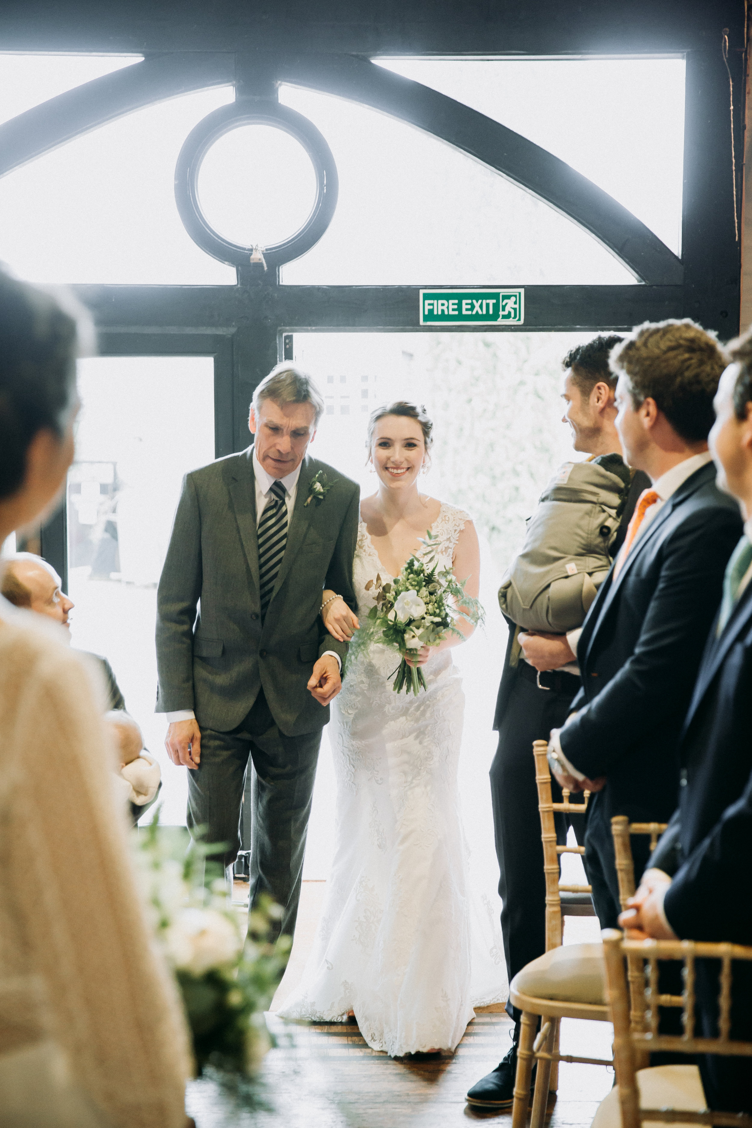 Hannah walking down the aisle at Old Luxter's Barn at The Chilterns wedding