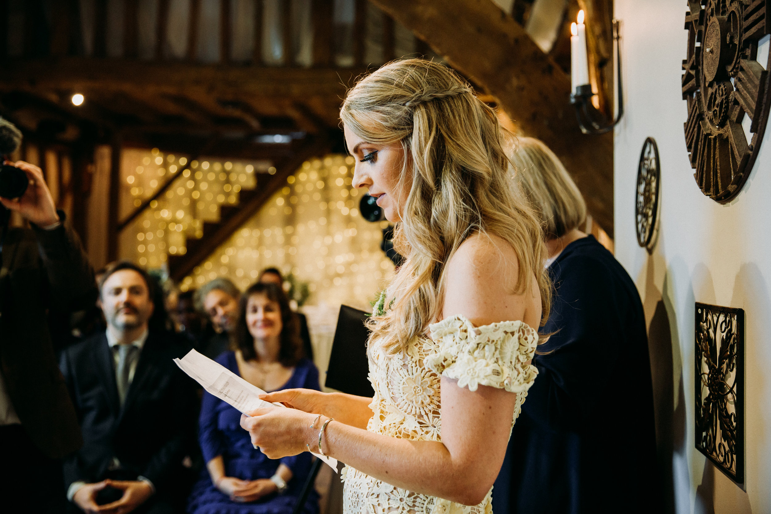 Poppy doing reading Vanessa & Hannah wedding ceremony at Old Luxter's Barn at The Chilterns wedding