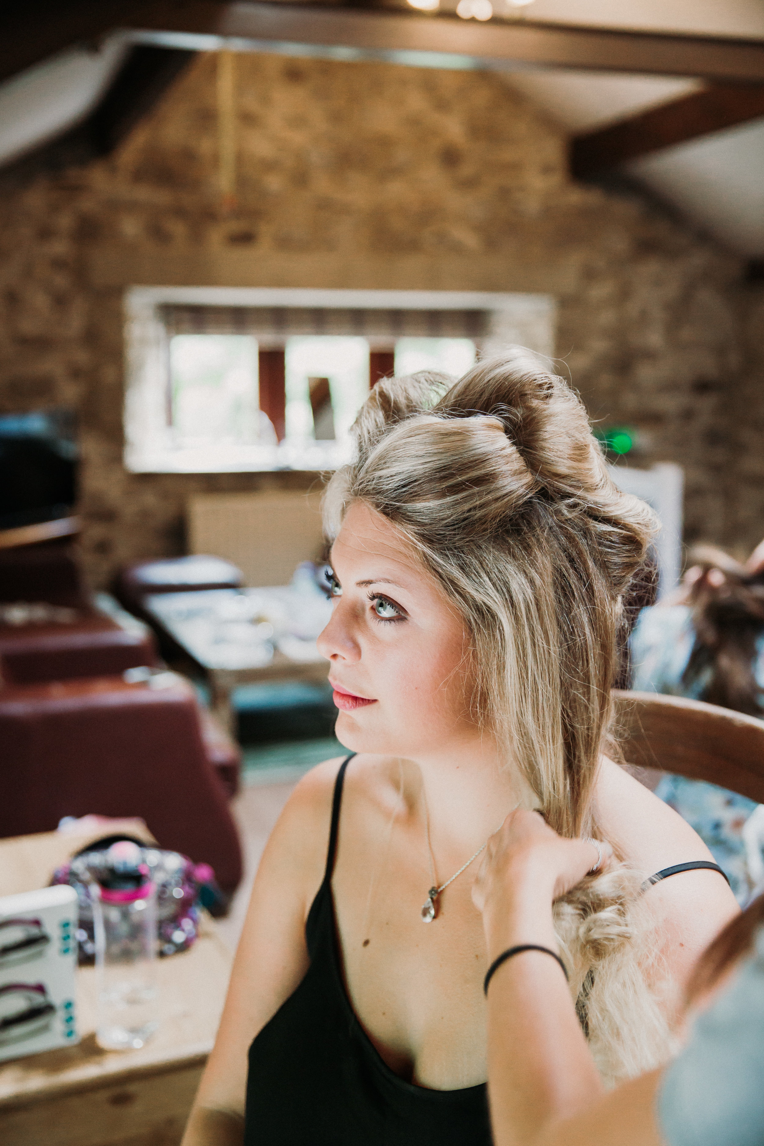 Bridesmaid getting ready at Kilnsey Park Estate