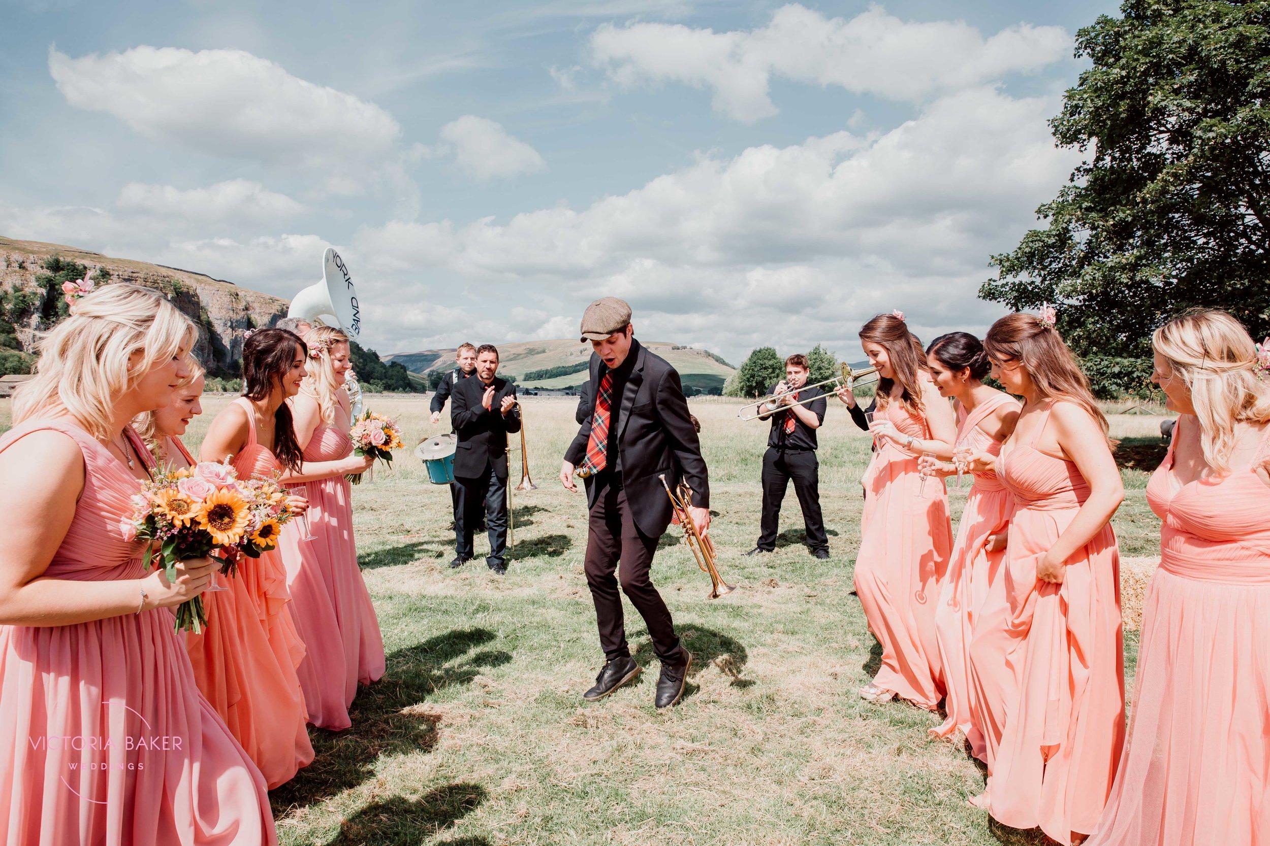 Dancing bridesmaids at Kilnsey Park Estate