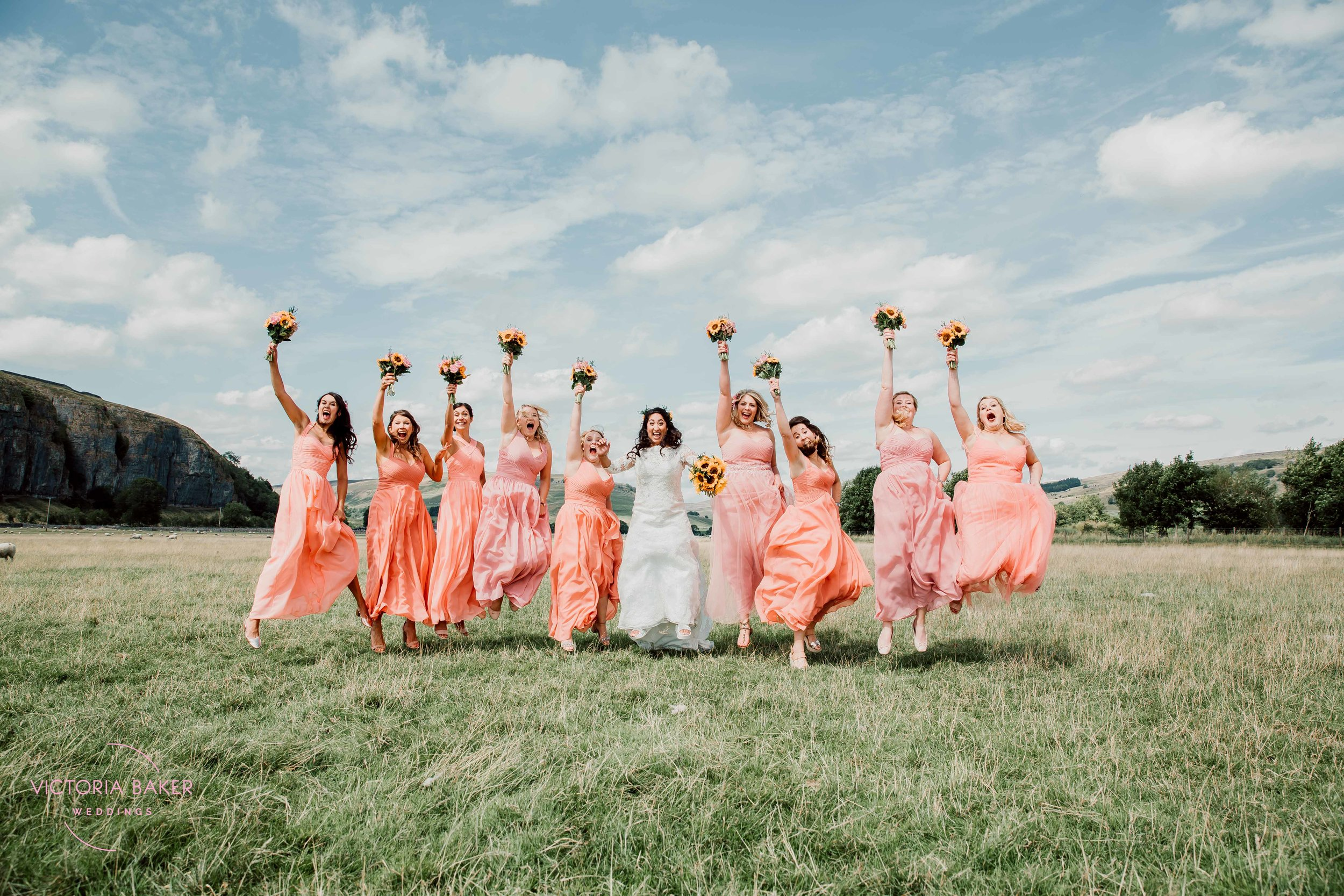 Jumping bridesmaids at Kilnsey Park Estate