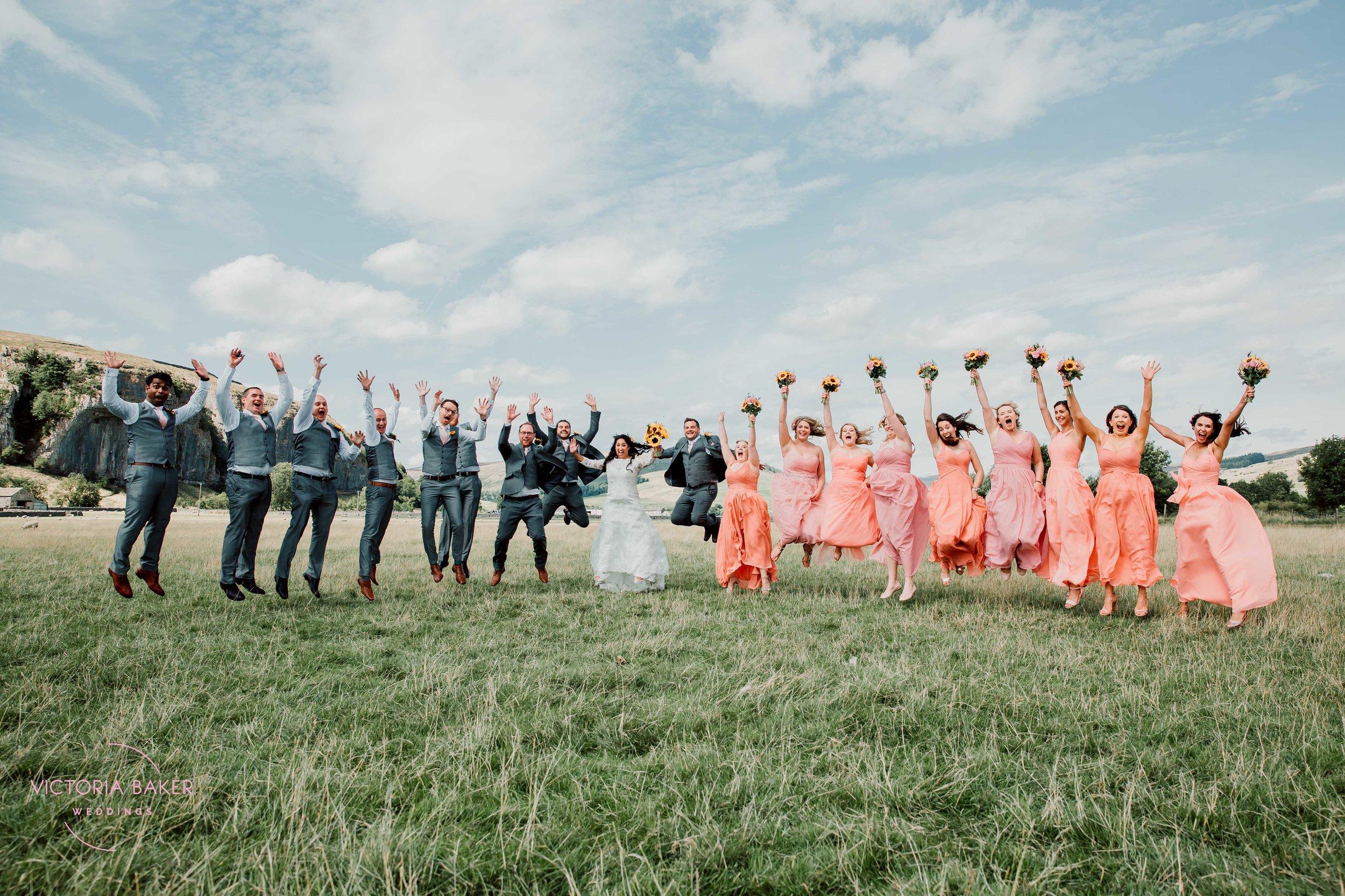 Jumping bridesmaids and ushers at Kilnsey Park Estate