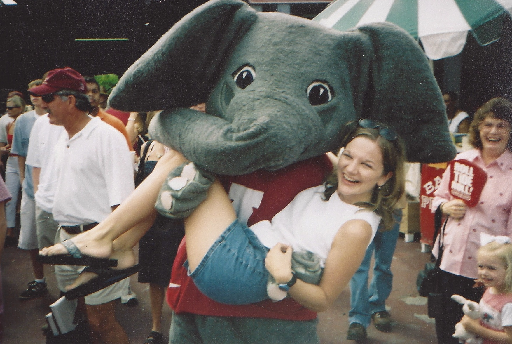 In college Jason (my husband) was the mascot. I think this is our best picture together ;)