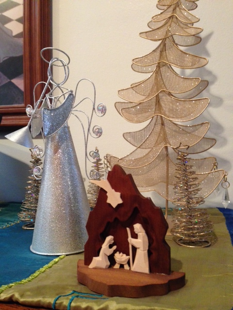 Hand made nativity scene I bought in Poland hanging with some glitter.