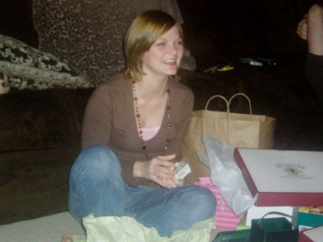 Christmas 2006.  The look of joy on Michelle's face to get the iPod she wanted. (iPods were still cool back then)