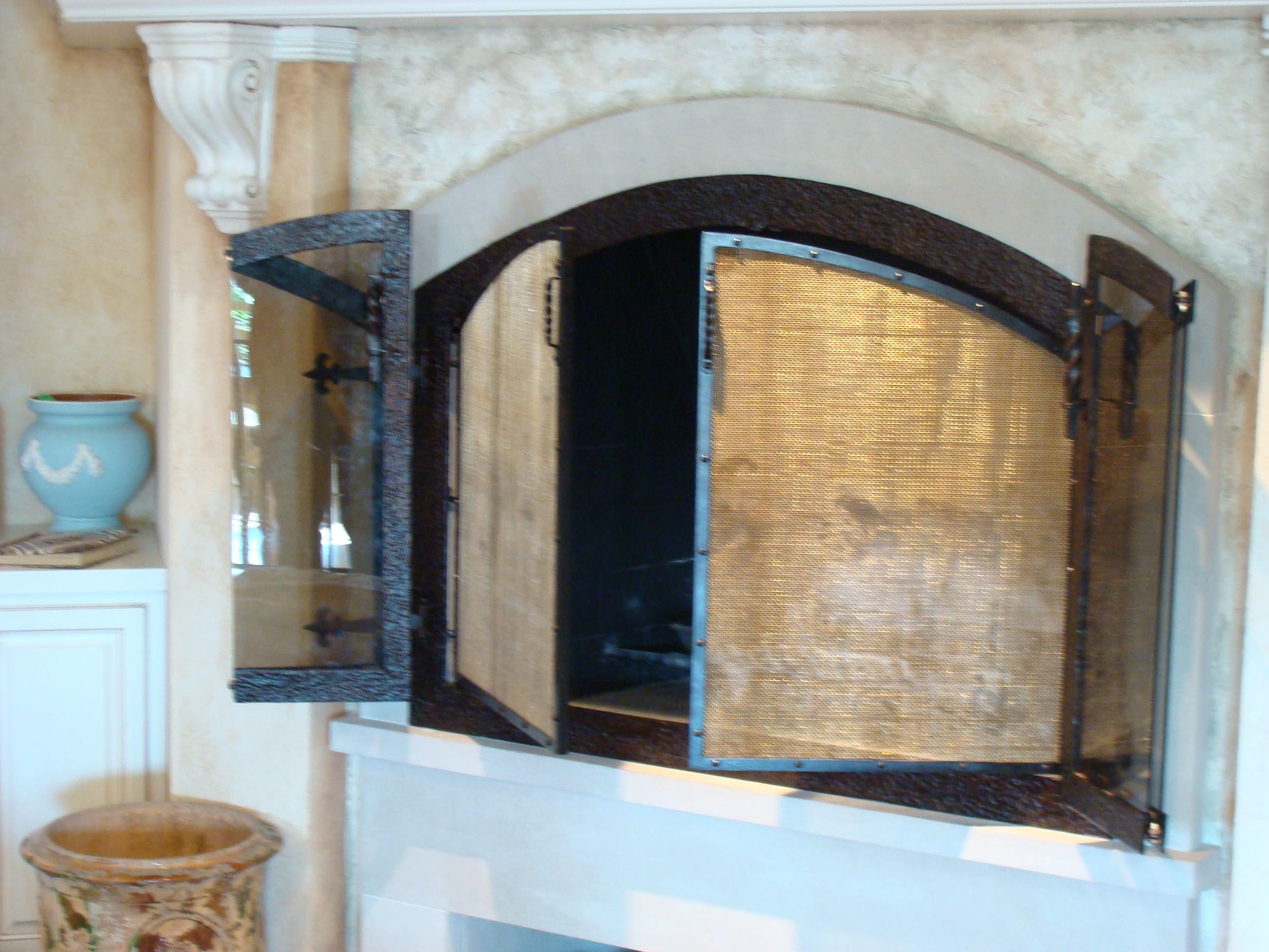 Custom forged steel fireplace enclosure