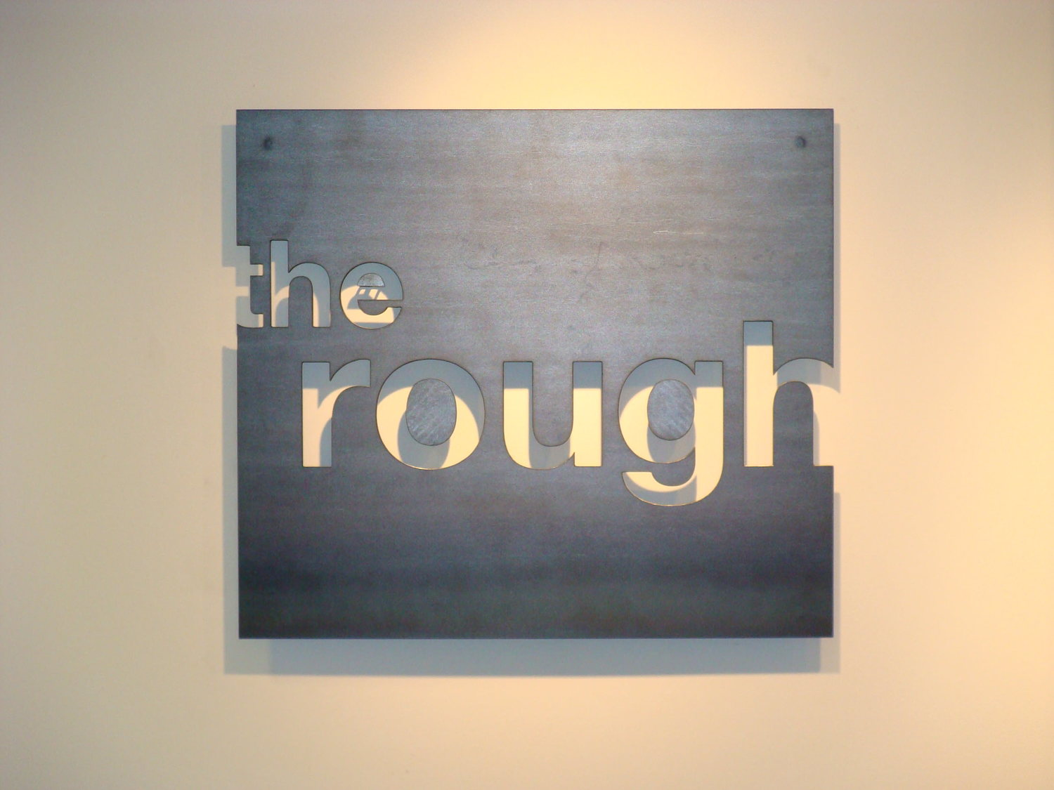 The Rough metal sign