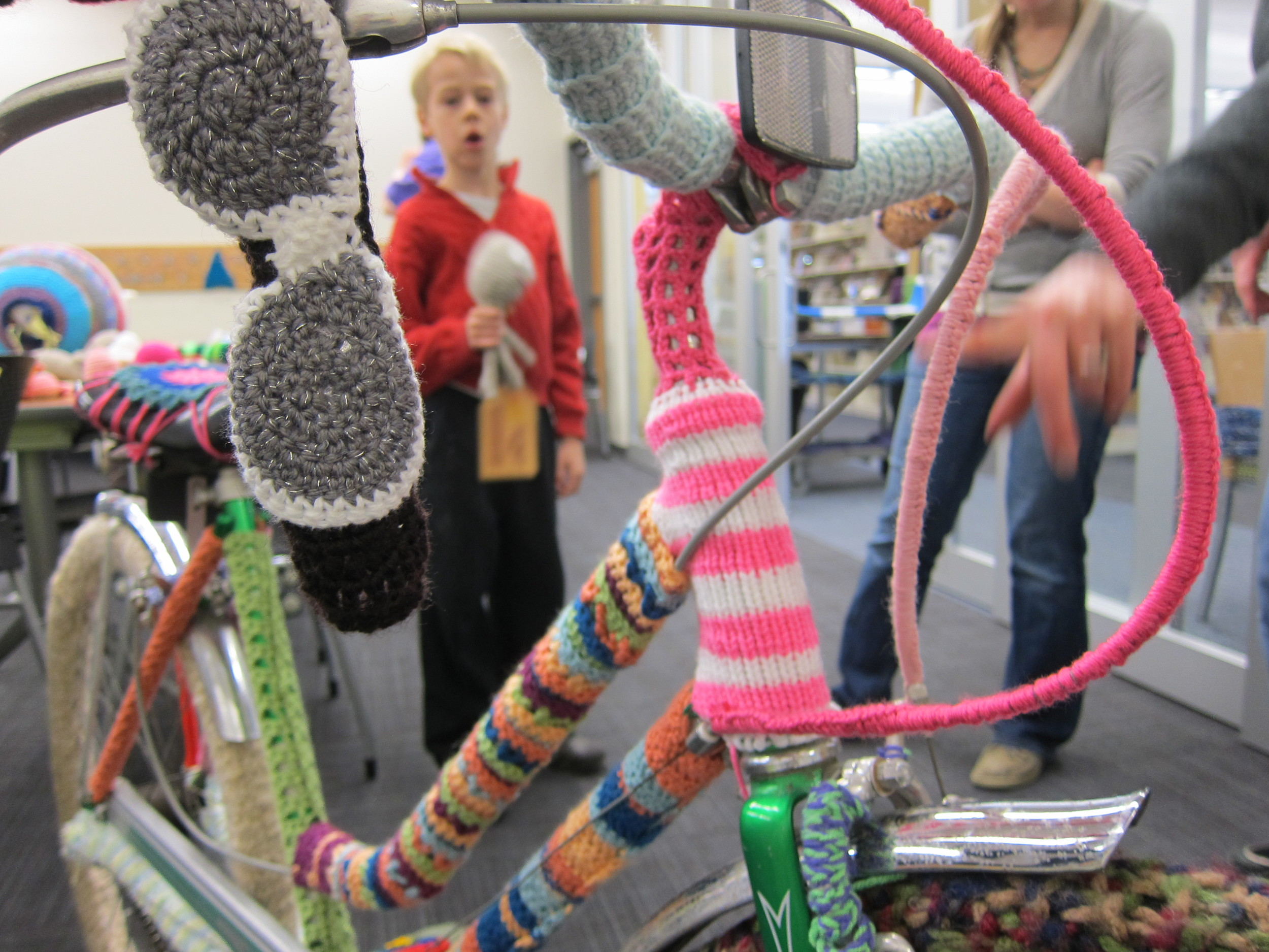 During a yarn knitting / bombing session at the Bubbler various object were covered in yarn - from book carts to this bike.
