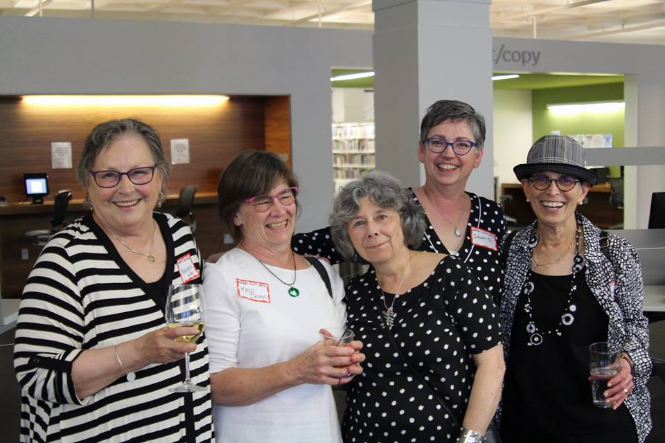 Copy of Memory Cloths Circle artists celebrating at the June opening at Central Library