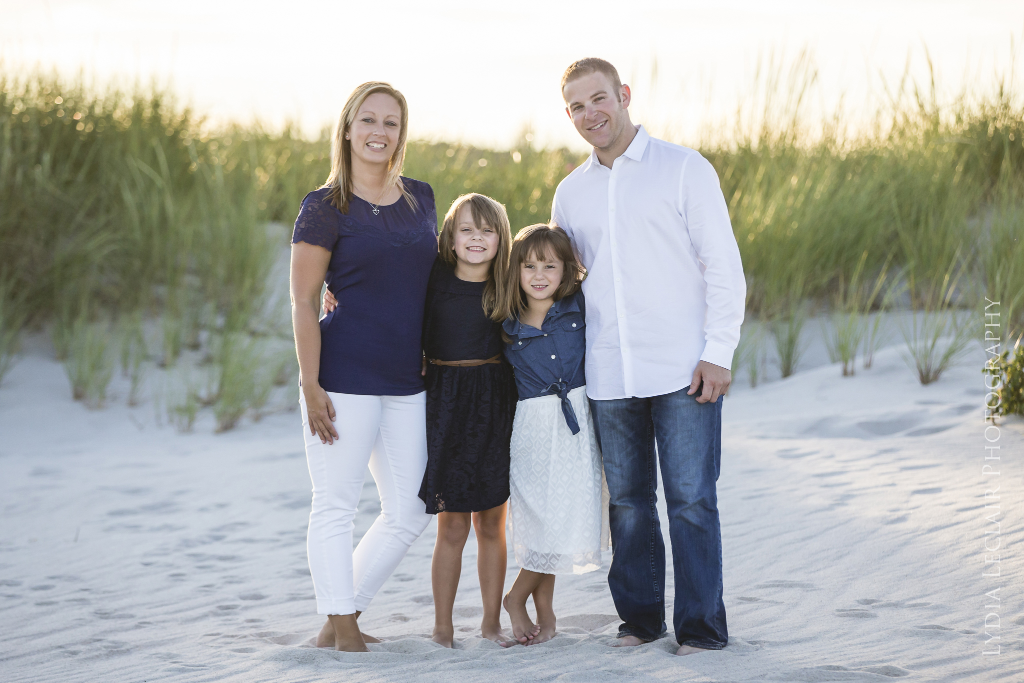 Beautiful family posing on a private beach after a boat ride from Wequassett Resort Harwich, MA