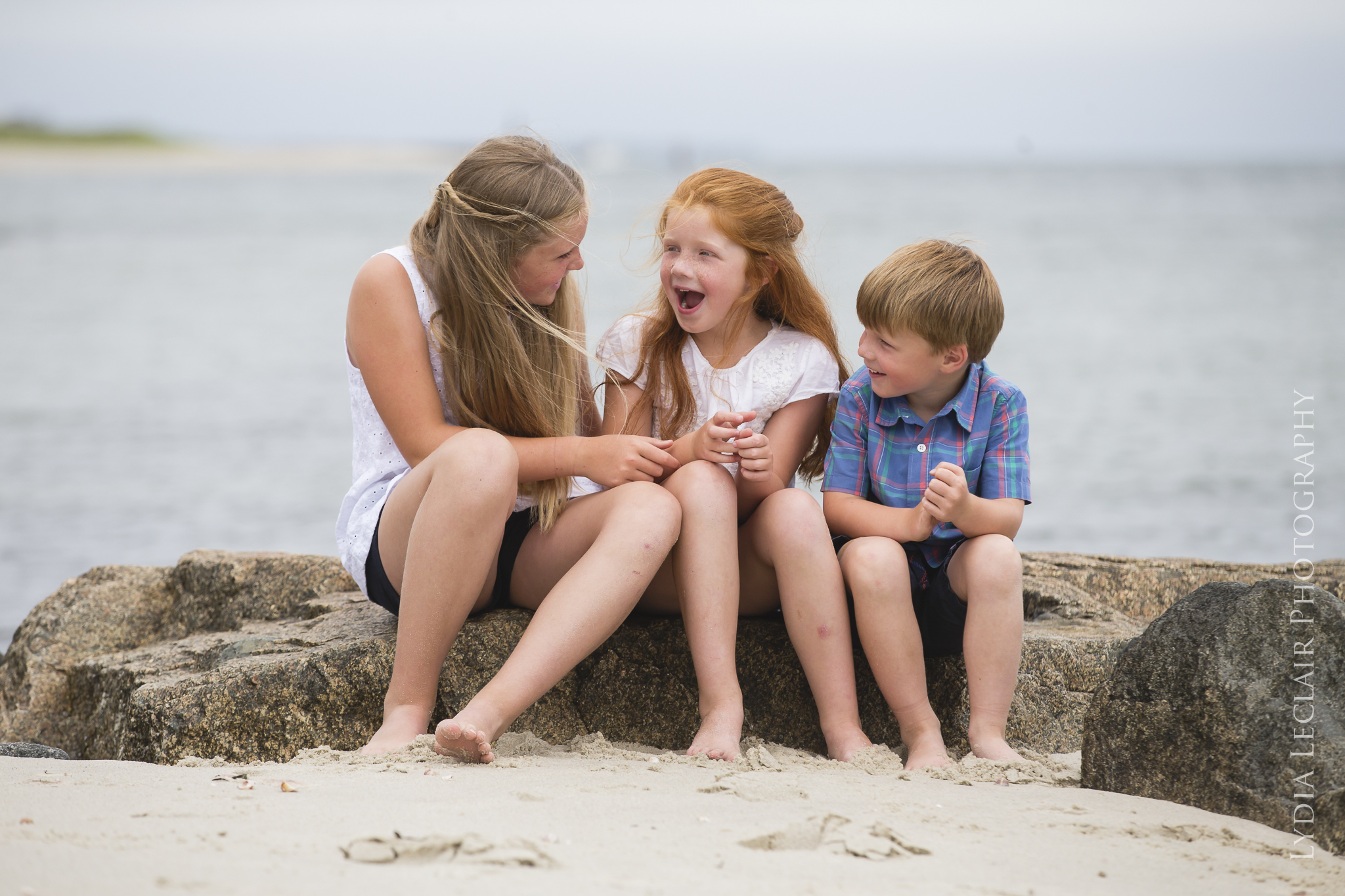 Kids having fun during this lifestyle documentary summer family shoot at the beach