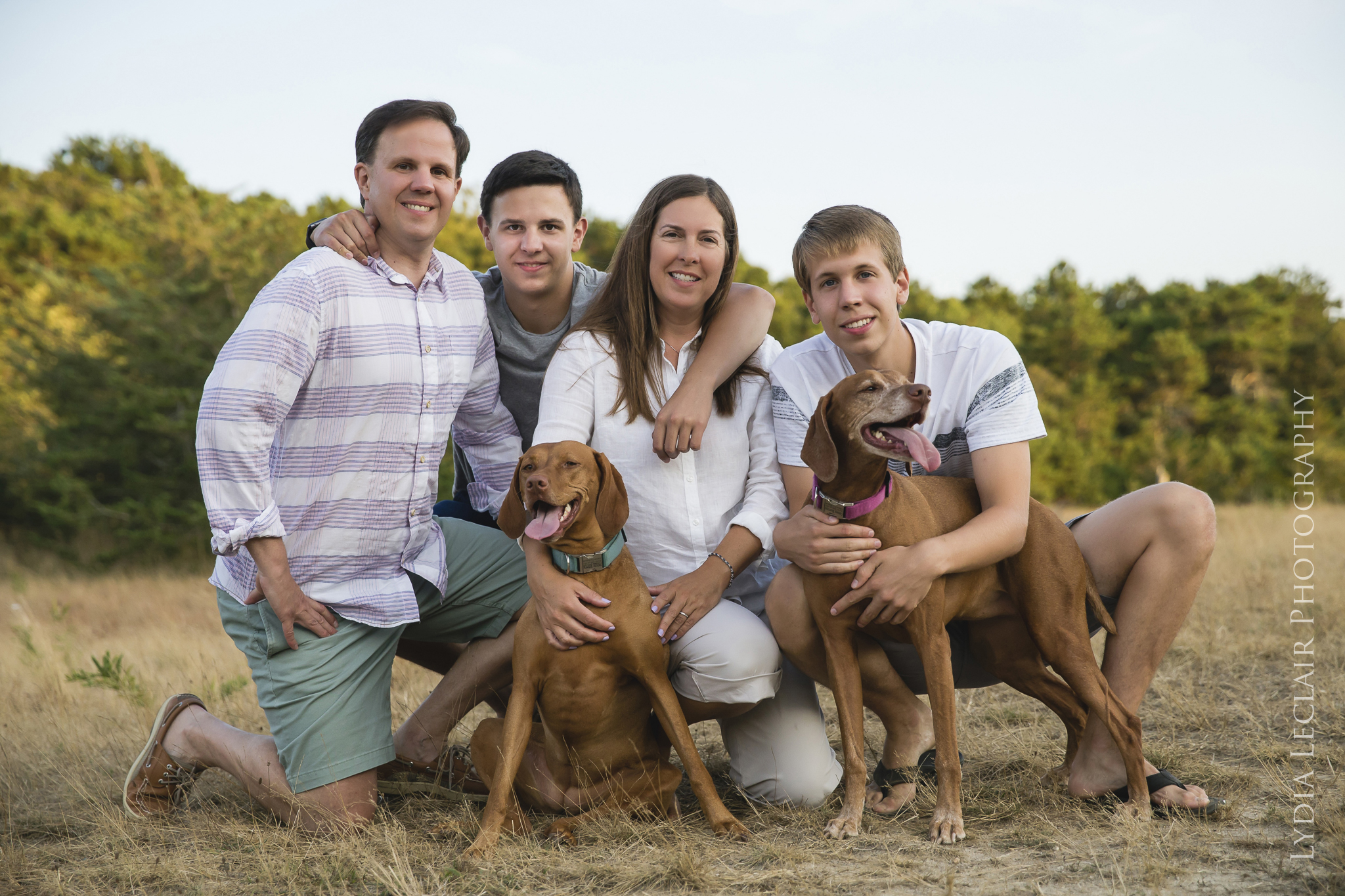 Rustic woods casual family portrait with dogs at Thompson Field in Harwich, MA