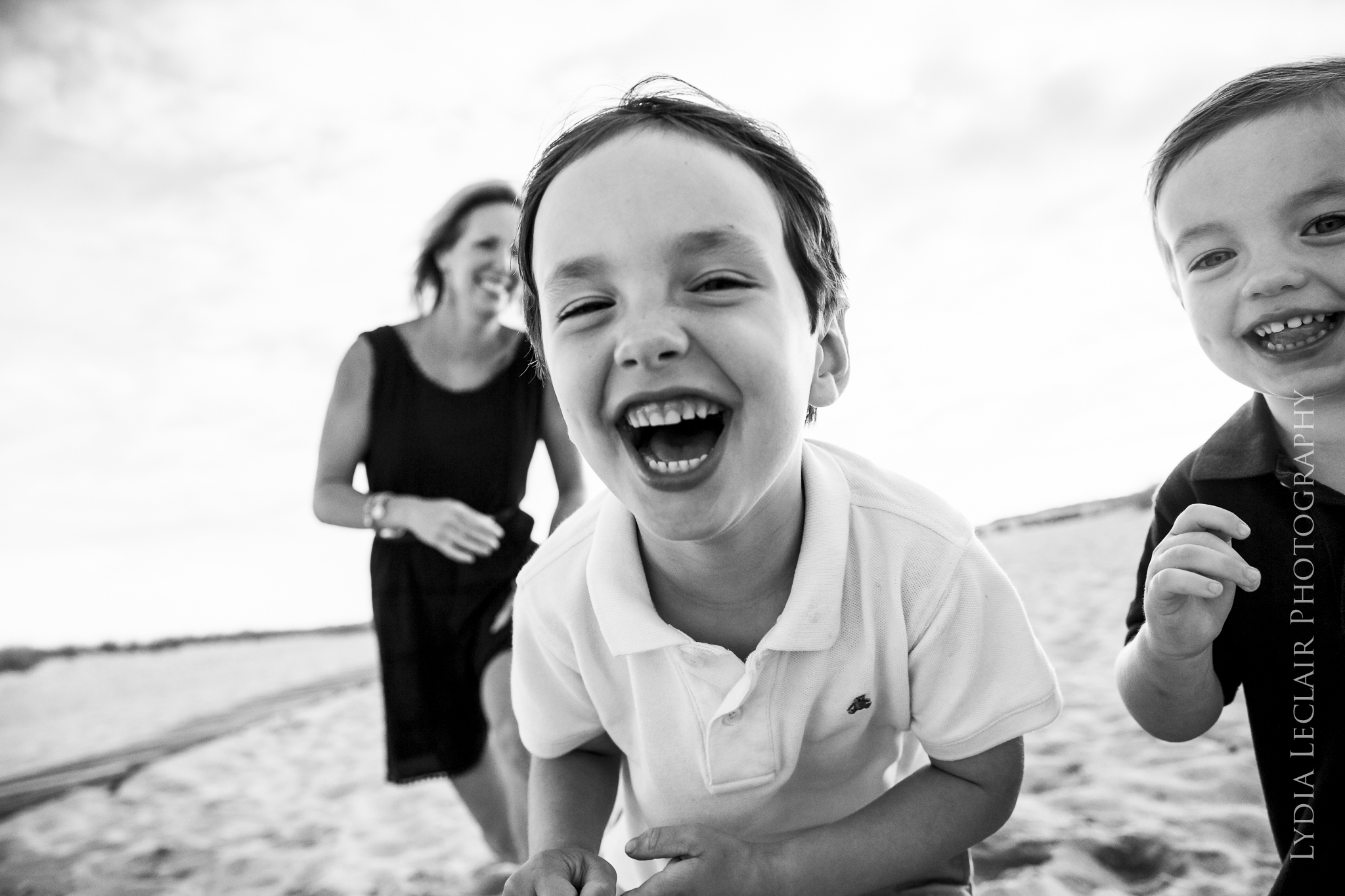 Candid kids laughing and playing at the beach in Truro