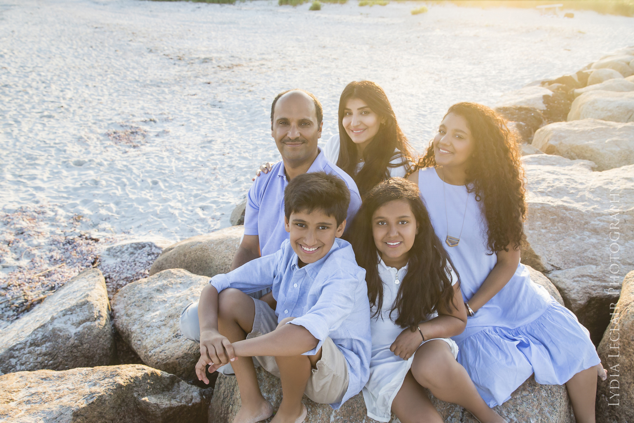 Osterville Dowses beach family photo on the rocks during sunset