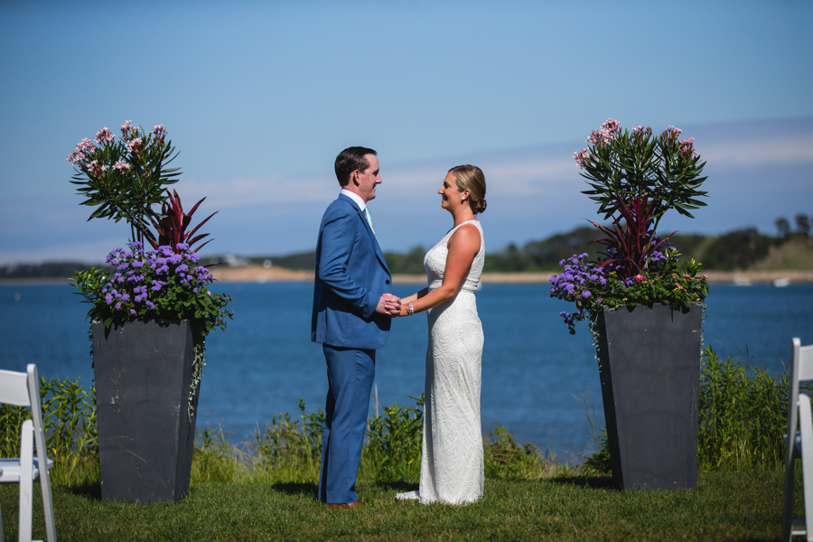 Wedding couple on the lawn with water background Harwich