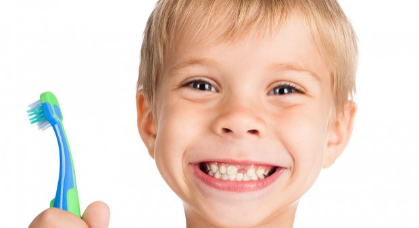 kid-with-toothbrush-620x350.jpg
