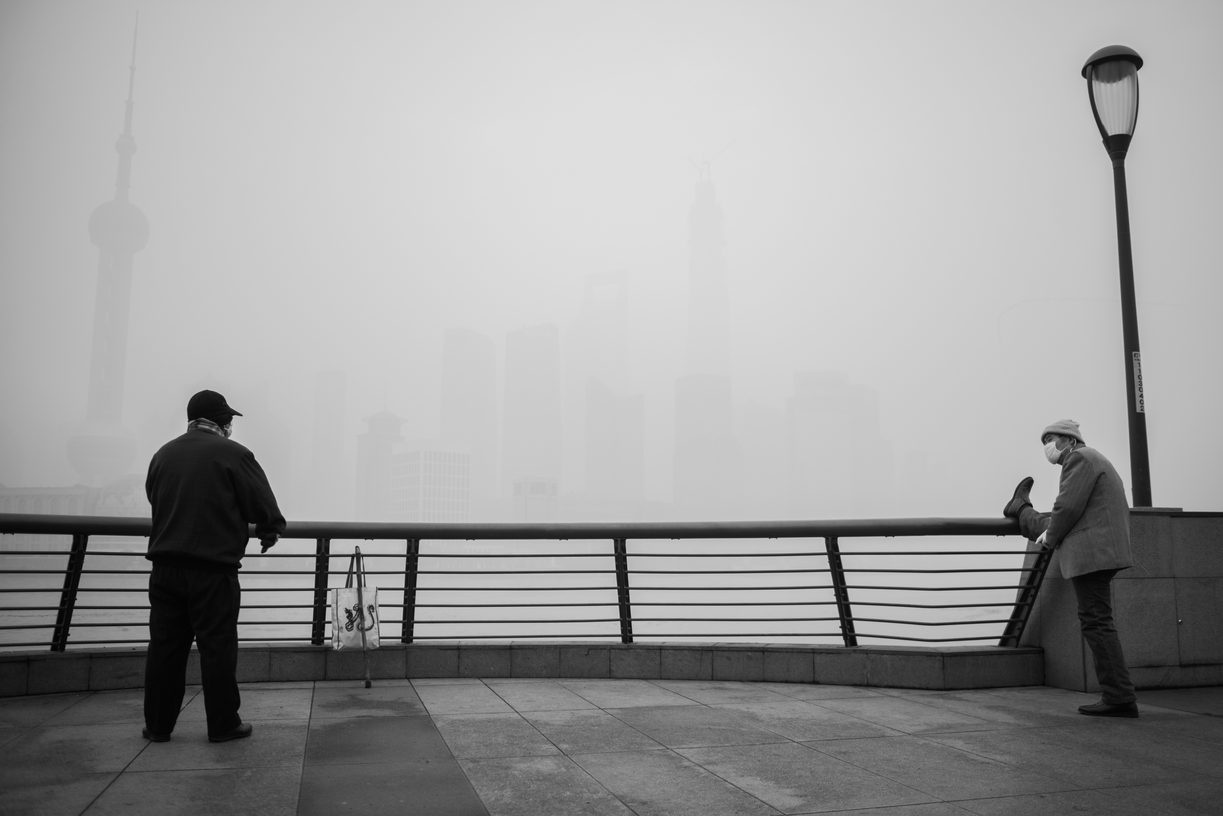 These guys were having a casual chat on the Bund at 6am, most likely about the pollution that managed to pull a curtain of smog across an otherwise magical sunrise view!