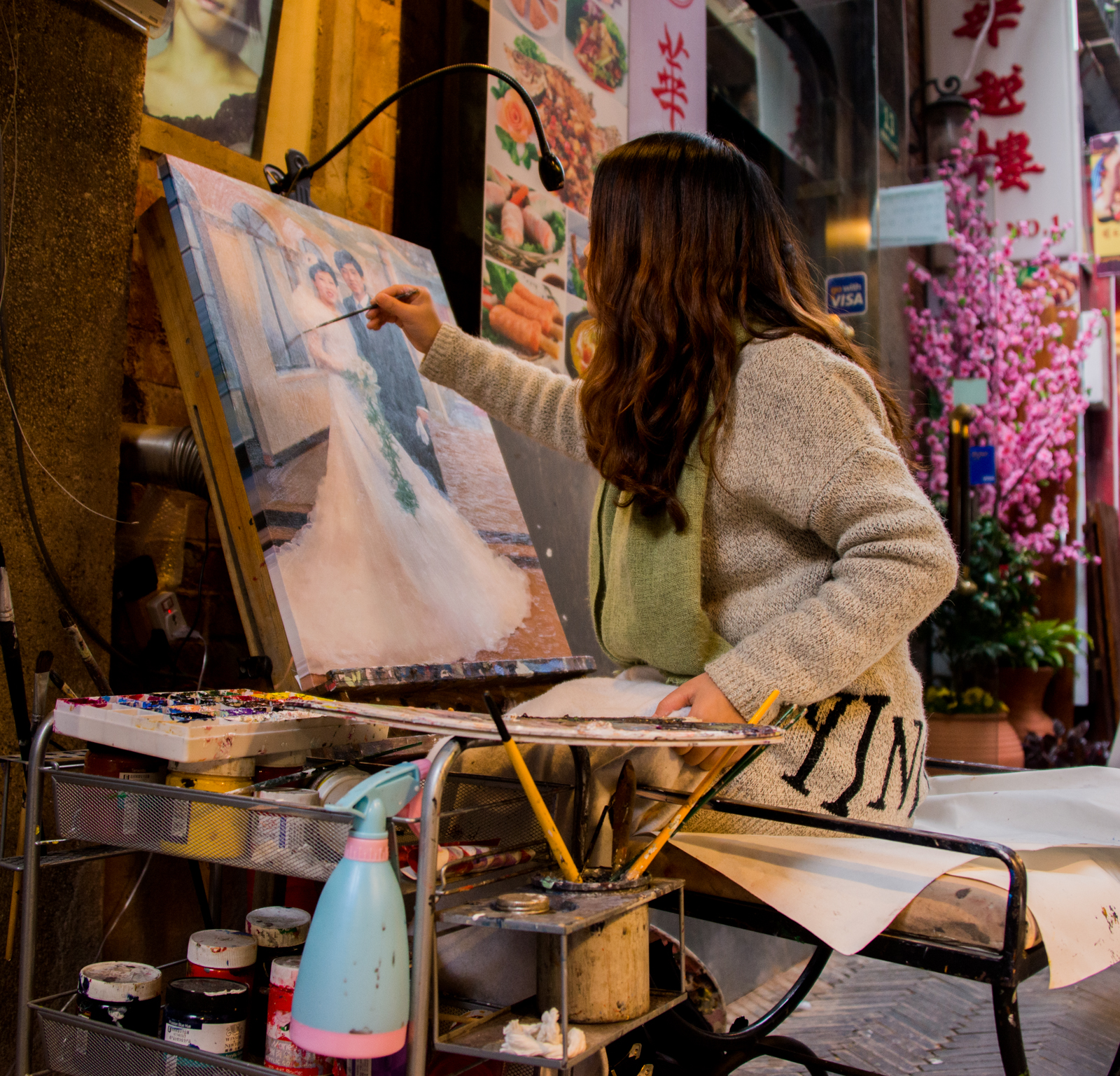 Tucked away in a small enclave in Shanghai is a small network of alleyways called 'The French Concession'. This area is home to craft beers, European style cuisine and artists of all stripes. This girl was finishing off a photo-realistic painting, so realistic that it makes you wonder if you should just stick with the photograph! I of course then took a photo of it to restore balance to an otherwise crazy situation.