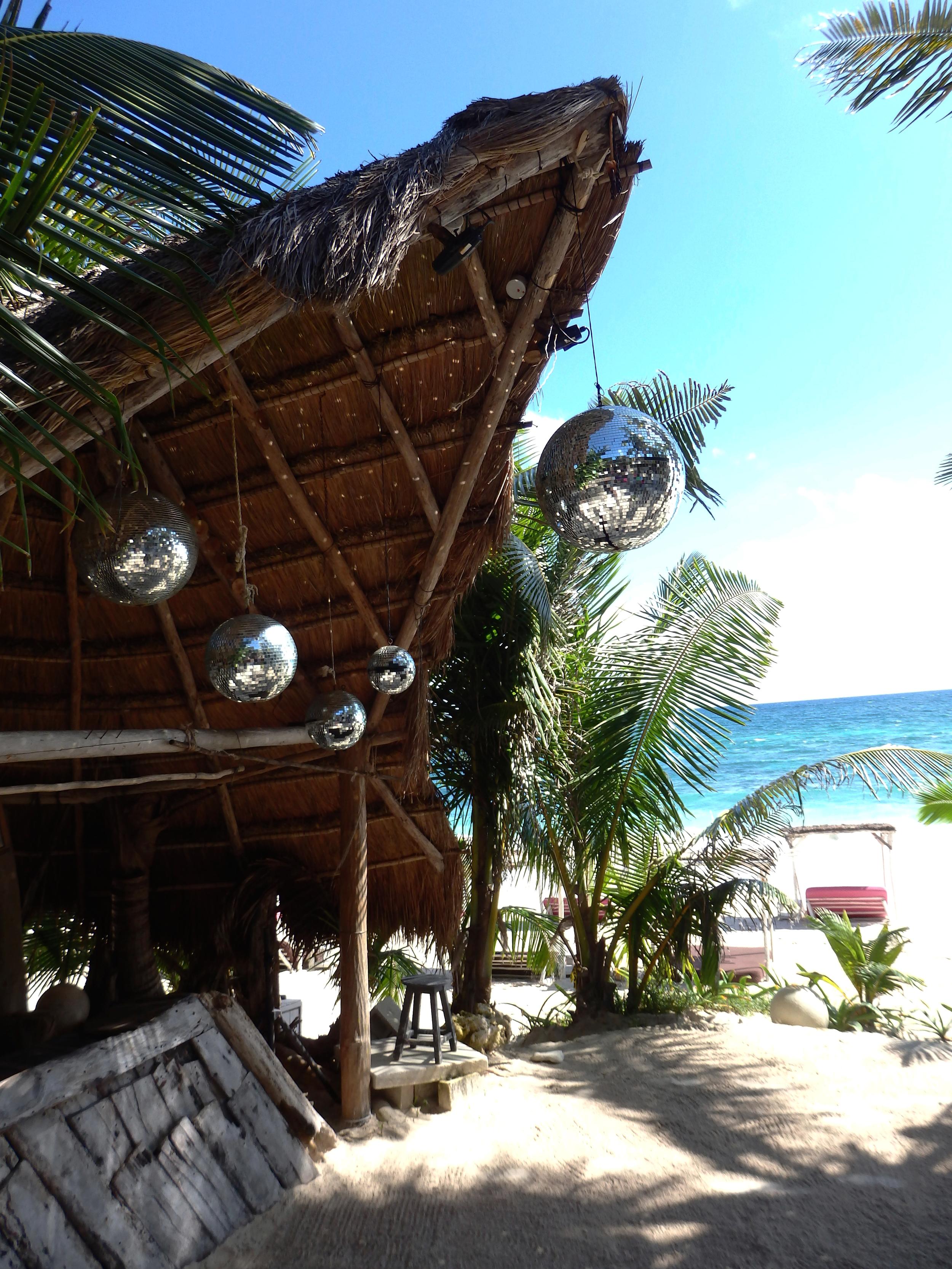 Papaya Playa DJ booth with disco balls // The Weekend Edit