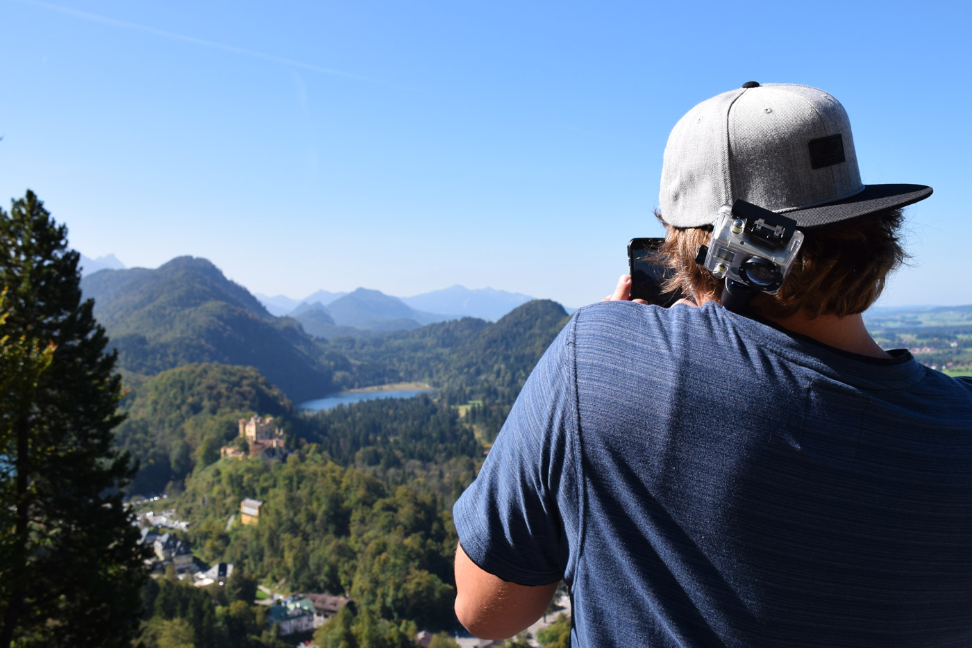 That's my brother, balancing a Go Pro on a selfie stick while instagramming a photo of a castle in Bavaria #doubletrouble