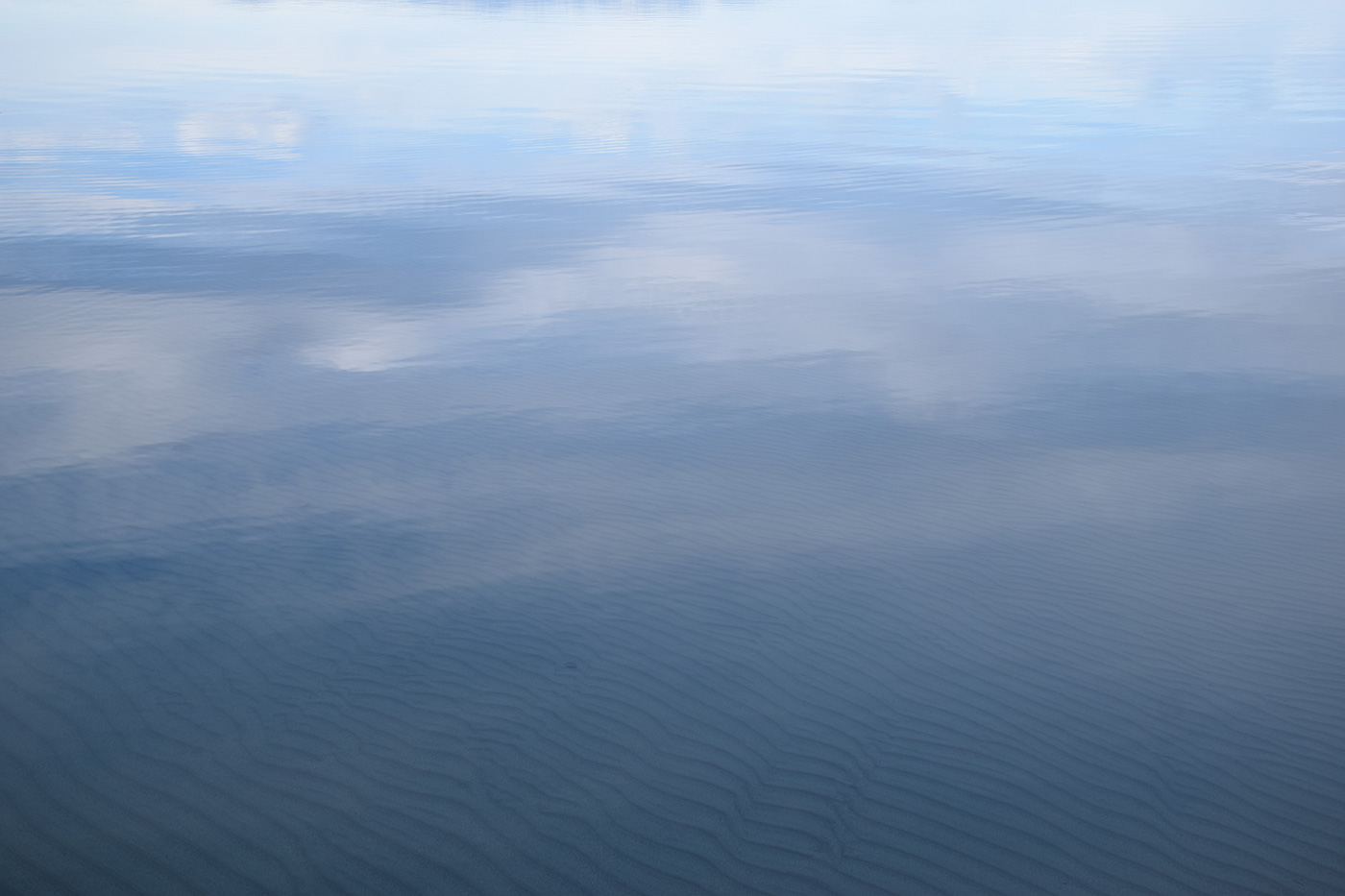 You can just make out the little sand ridges under the water from the waves at the lake the day before.