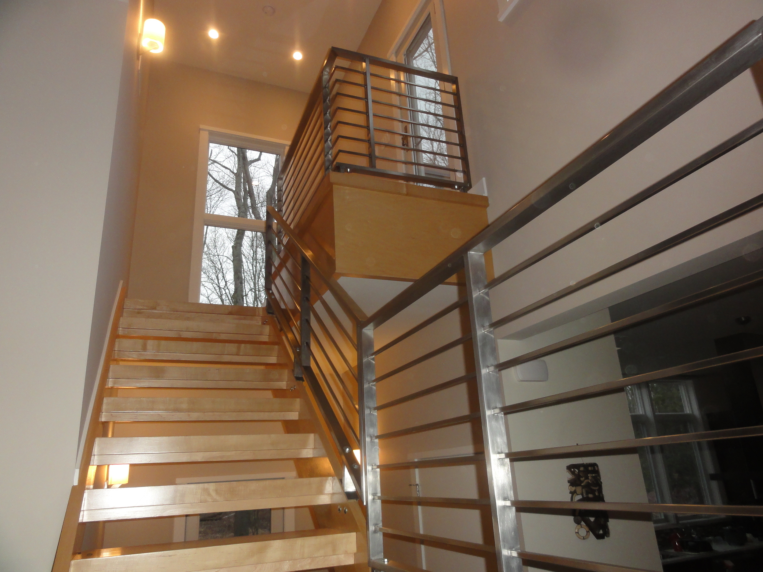 Wood staircase and custom railing