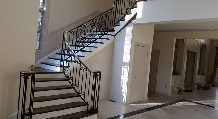 Traditional curved stairs with ornamental railing