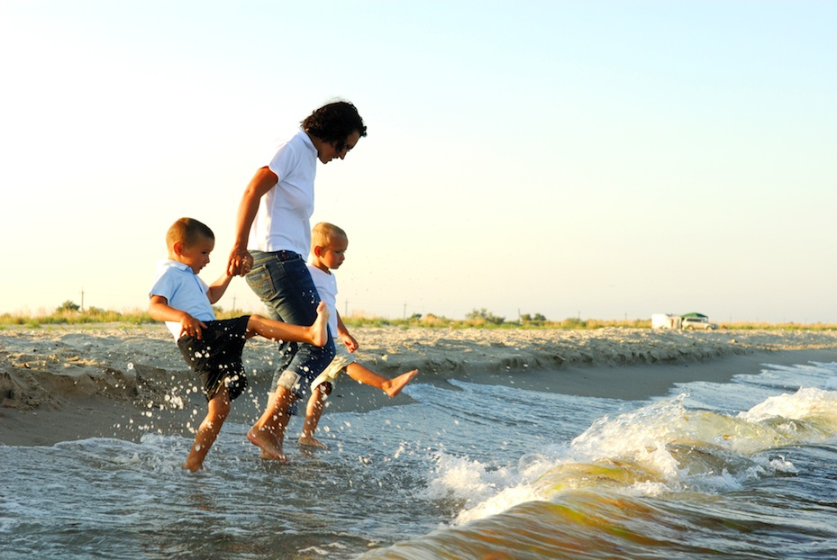 2013 01 04 woman and 2 boys in surf at beach jeans beige .jpg