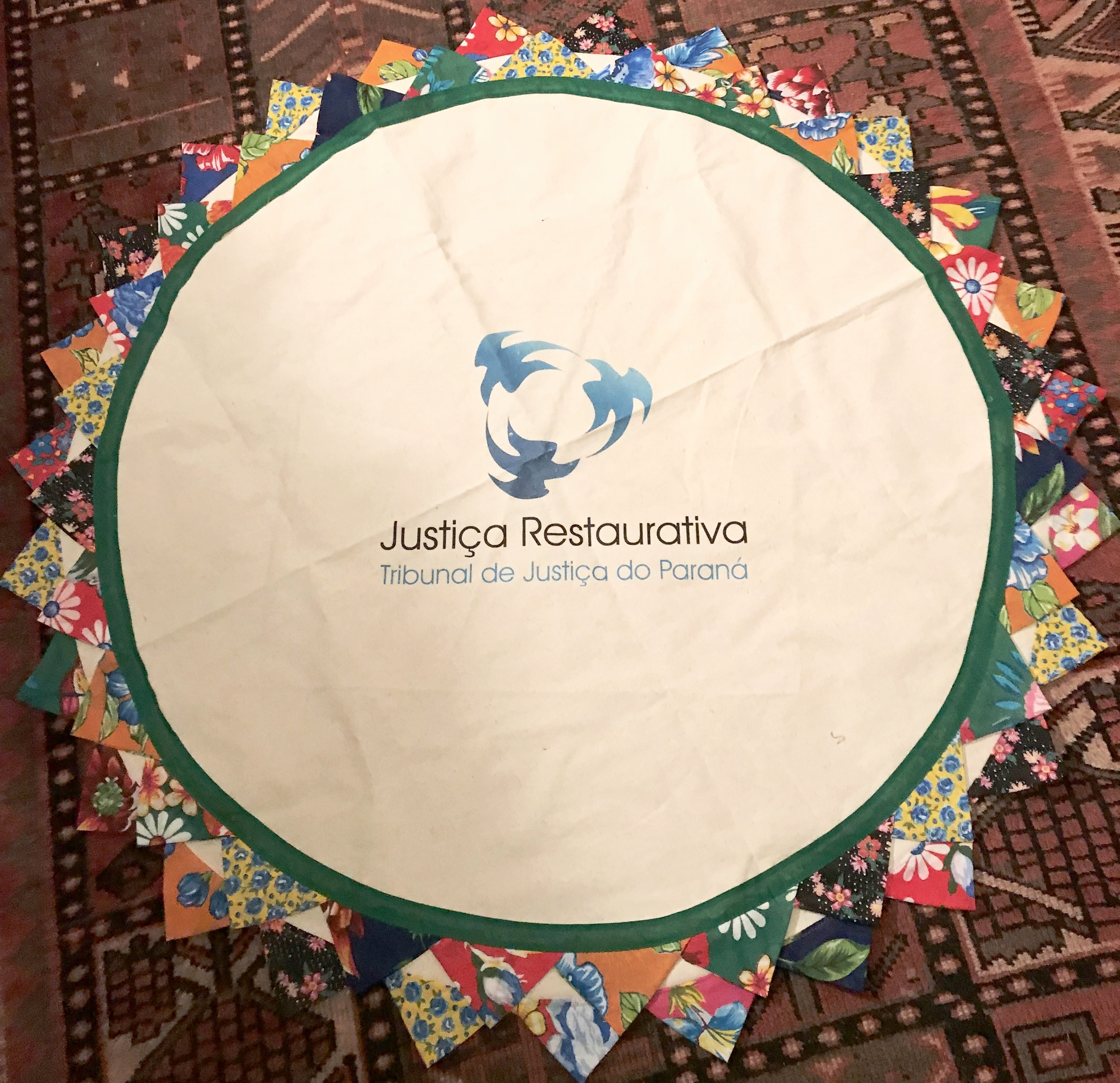 Certainly, a highlight of the morning was a beautiful gift from Jurema Carolina Gomez, representing Tribunal de Justica Restaurative. The handcrafted circle cloth includes their signature,a design depicting restorative justice in the center.