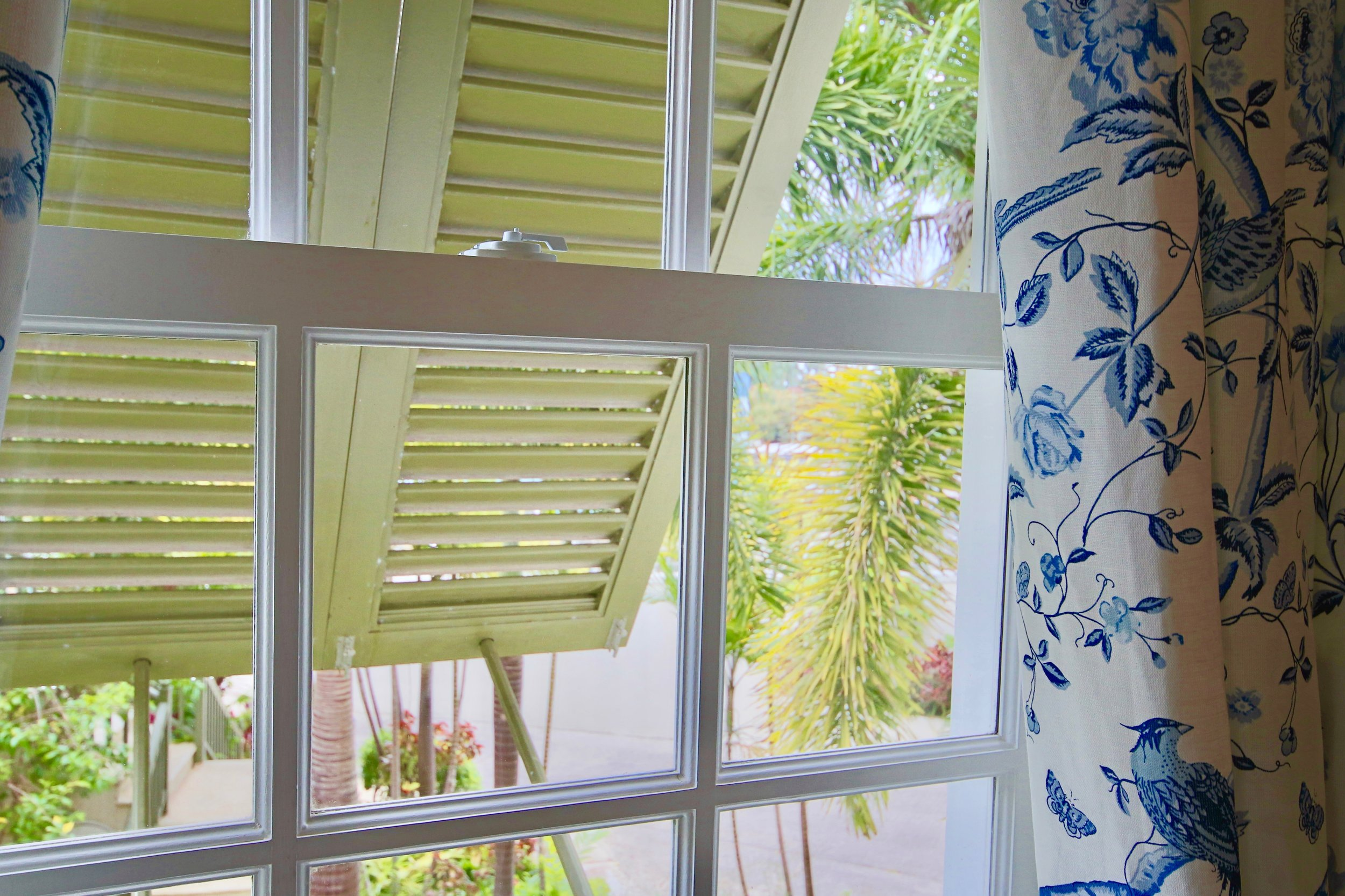 Traditional shutters on all windows