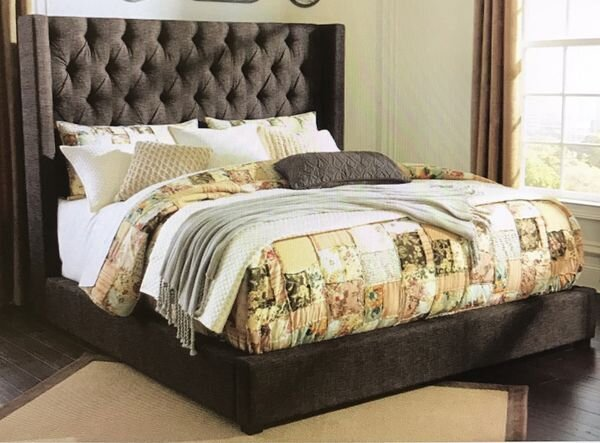 """QUEEN UPHOLSTERED DARK BROWN BED FRAME - Liquidation Price- $599New (never used)Queen, dark brown upholstered bed frame. Brand new - never used No mattress and no box spring included69 x 72 x 69""""HASHB599-174, 177"""