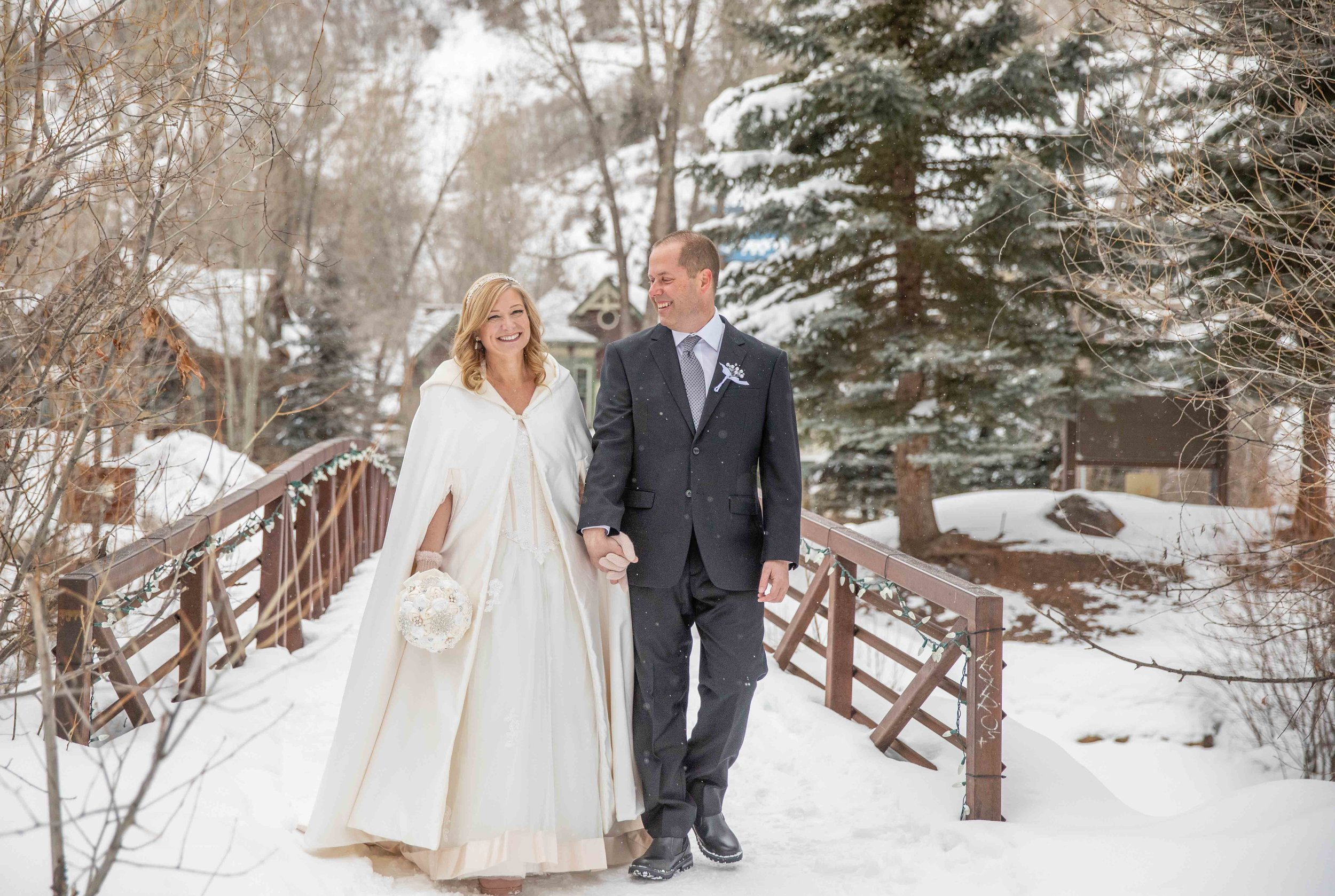 Kay & Craig - Lisa Marie was an amazing professional and an absolute blessing. She made our wedding photos magically enchanting. We have received countless admirations and accolades from our friends and family at how beautiful our winter wonderland bridge, ski lift, and Telluride town photos came out. We can't thank you enough for bringing the umbrellas and rolling with the snow storm without skipping a beat. We heartily recommend Lisa Marie to shoot your special event and to capture those candid moments so perfectly.