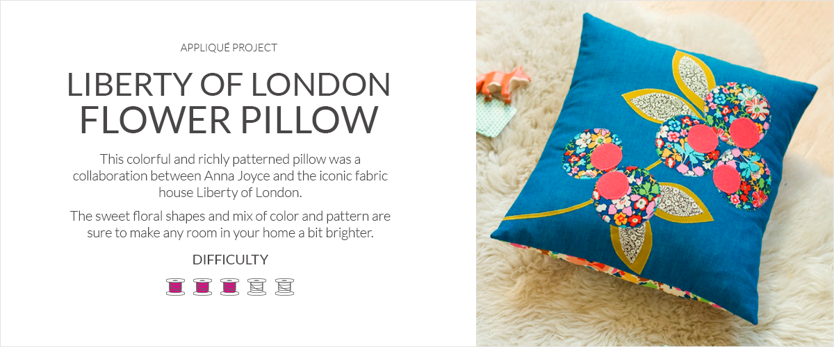 Liberty of London Flower Pillow  This colorful and richly patterned pillow was design was a collaboration between Anna Joyce and the iconic fabric house Liberty of London.  The sweet floral shapes and mix of color and pattern are sure to make any room in your home a bit brighter.  Difficulty 3 out of 5 spools