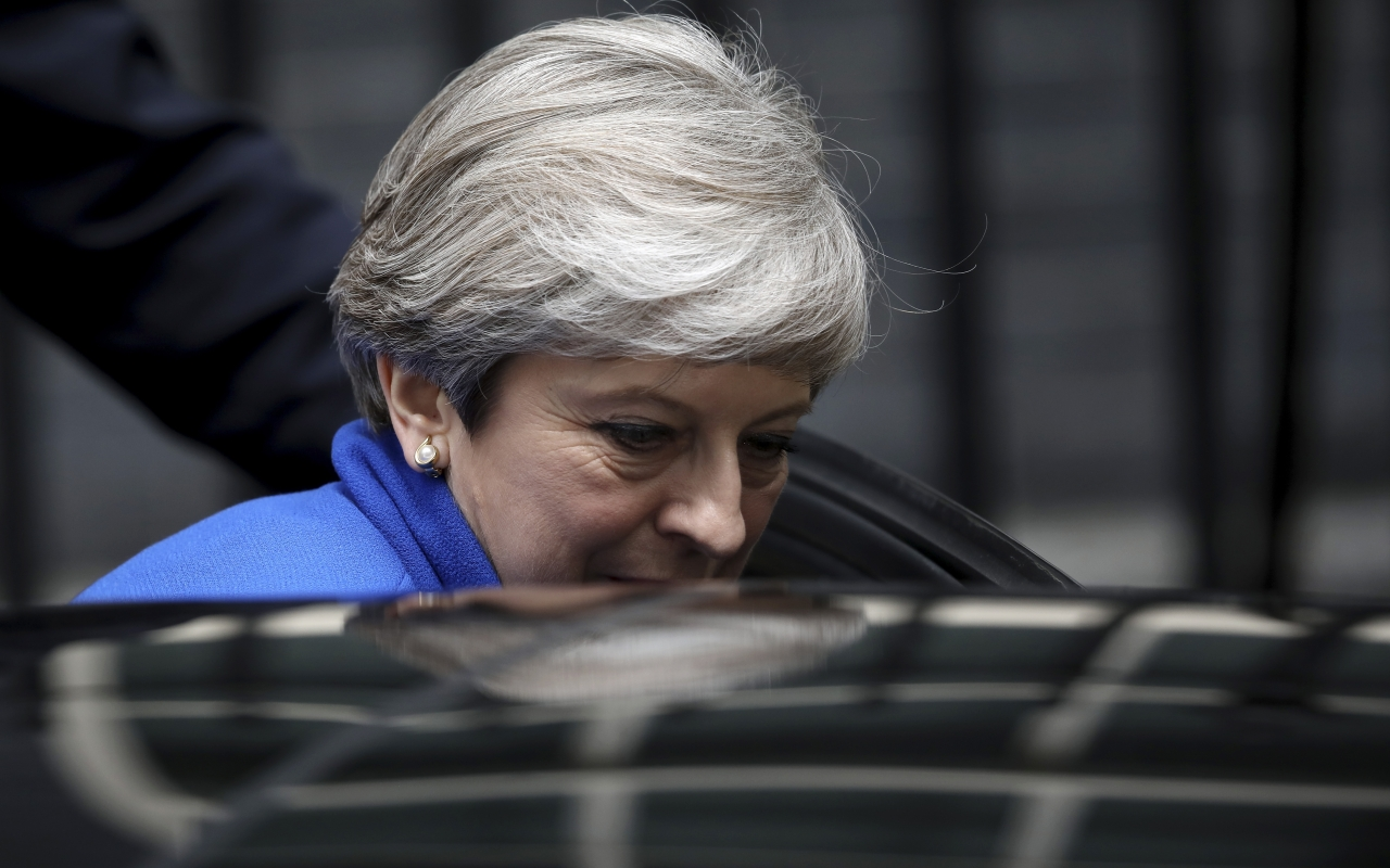 Theresa May leaving Downing Street following her statement on the election result (New Statesman/GETTY IMAGES)