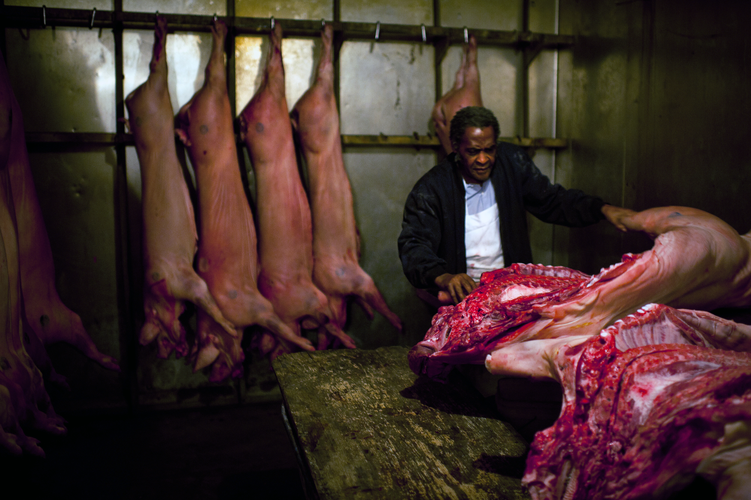 Pitmaster James Henry Howell checks his pigs at the Skylight.