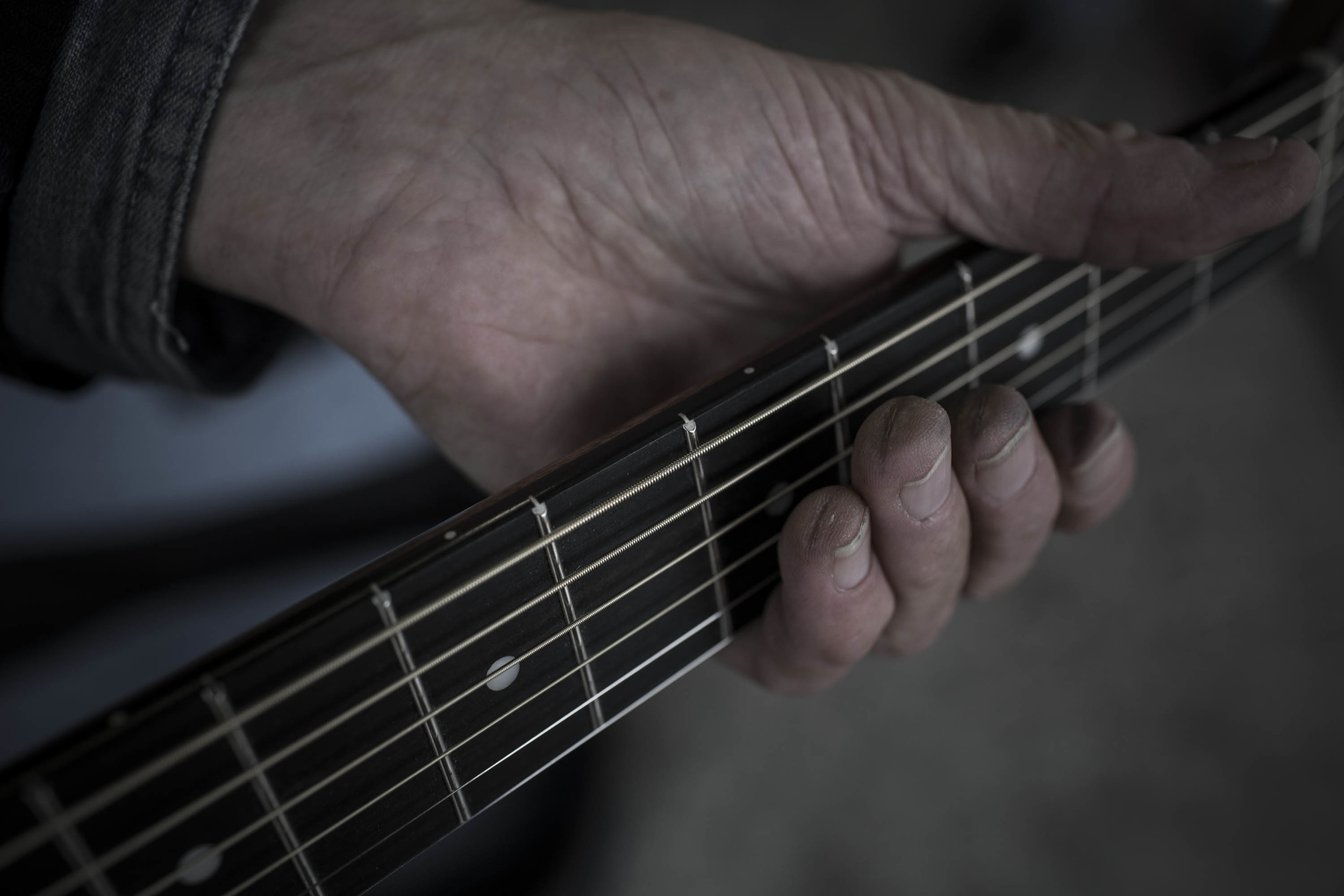 Over the decades, Doug Seegers has developed thick guitar-string calluses on his fingertips.