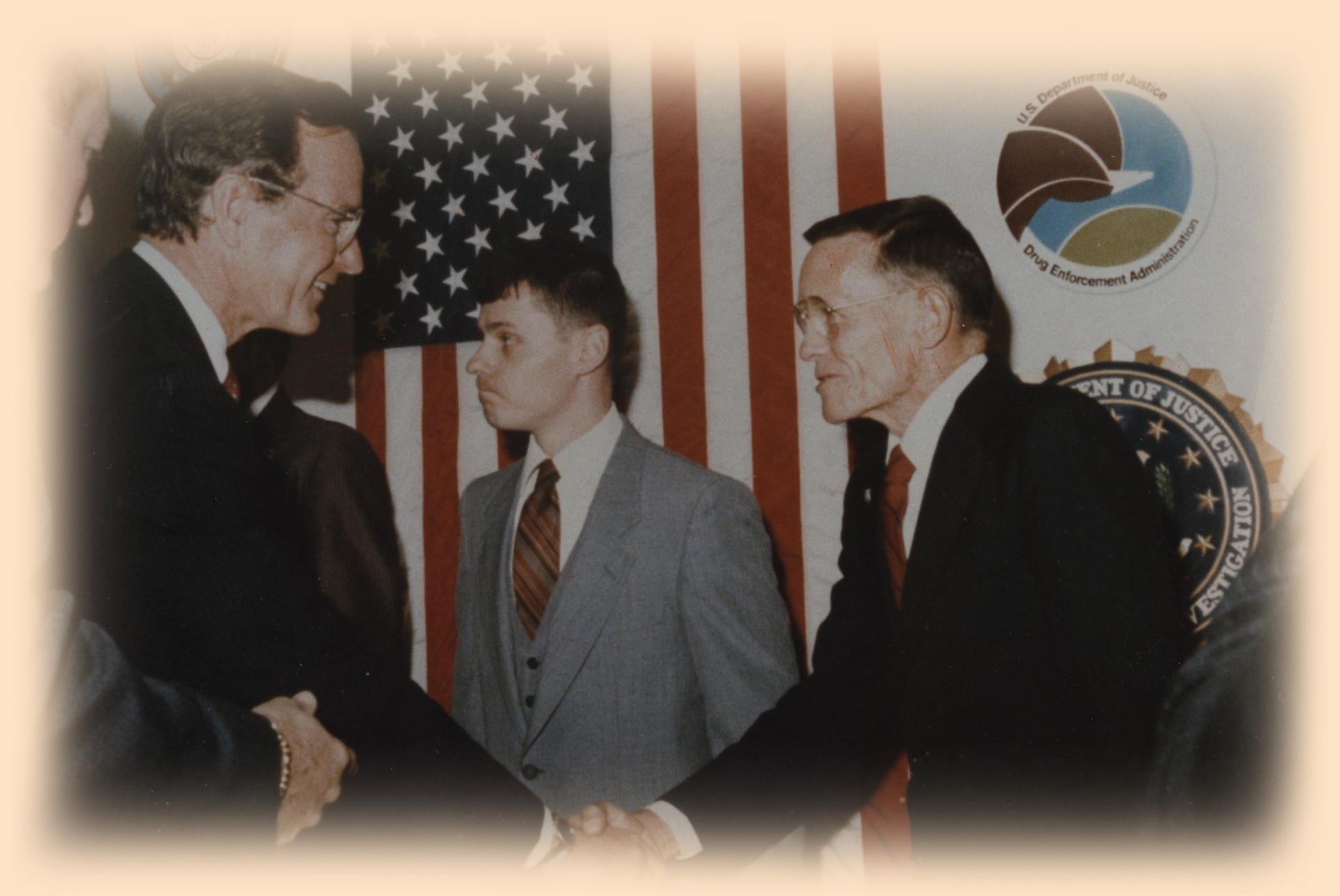 Fuss shakes hands with his boss, vice president George H.W. Bush