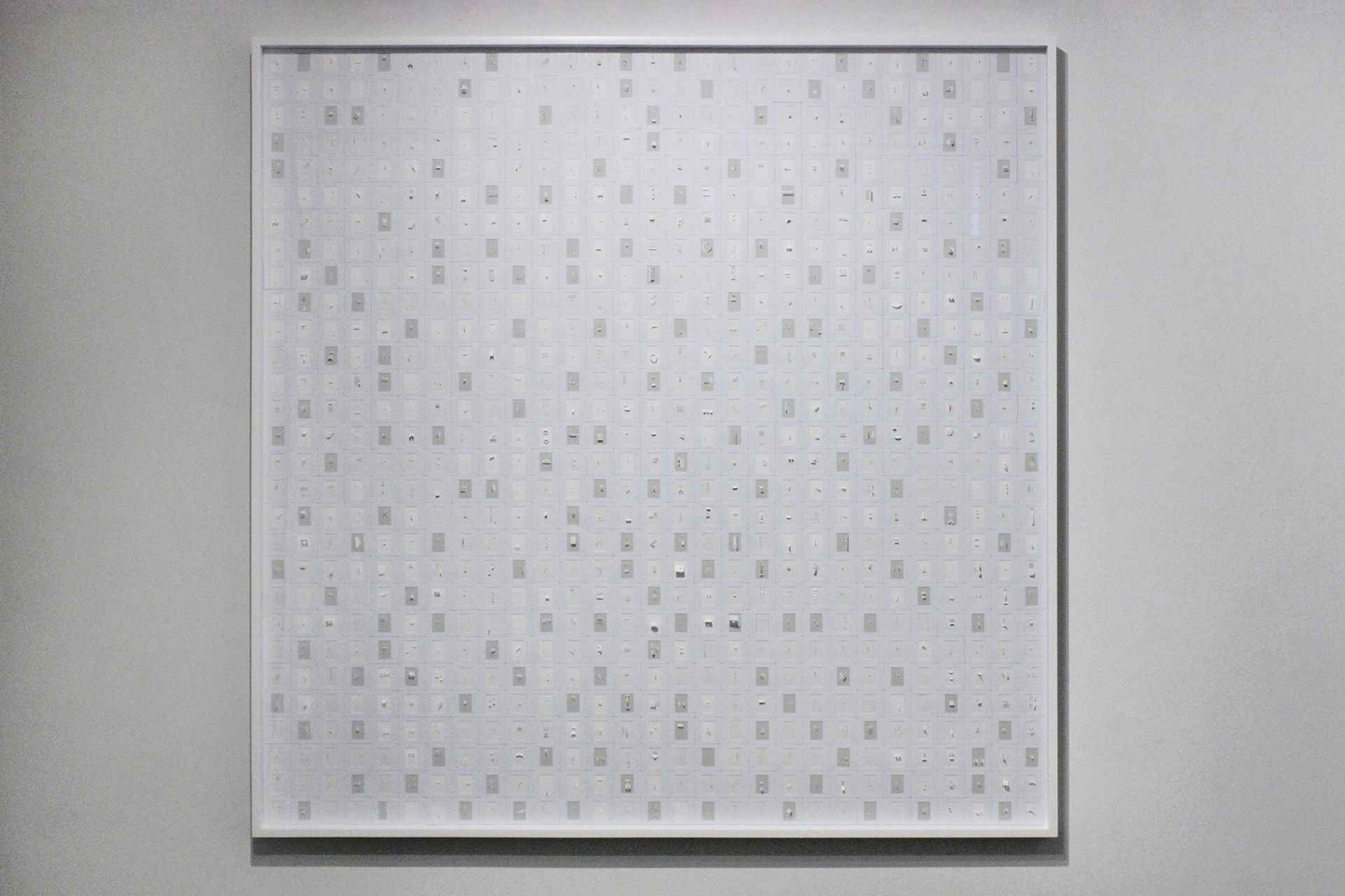 MARCO MAGGI   SPELLING SQUARE (G & W), 2016   CUTS AND FOLDS ON 841 WHITE AND GREY ARCHIVAL PAPERS IN 35MM SLIDE MOUNTS ON SINTRA   59 X 59 INCHES, 60 X 60 INCHES FRAMED   MM229