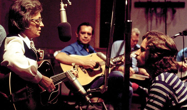 Mother Maybelle Carter in the studio with Jeff Hanna (at right) in 1971. When this picture was made, Carter was 62, and Hanna was 24. This summer, Hanna will turn 70.