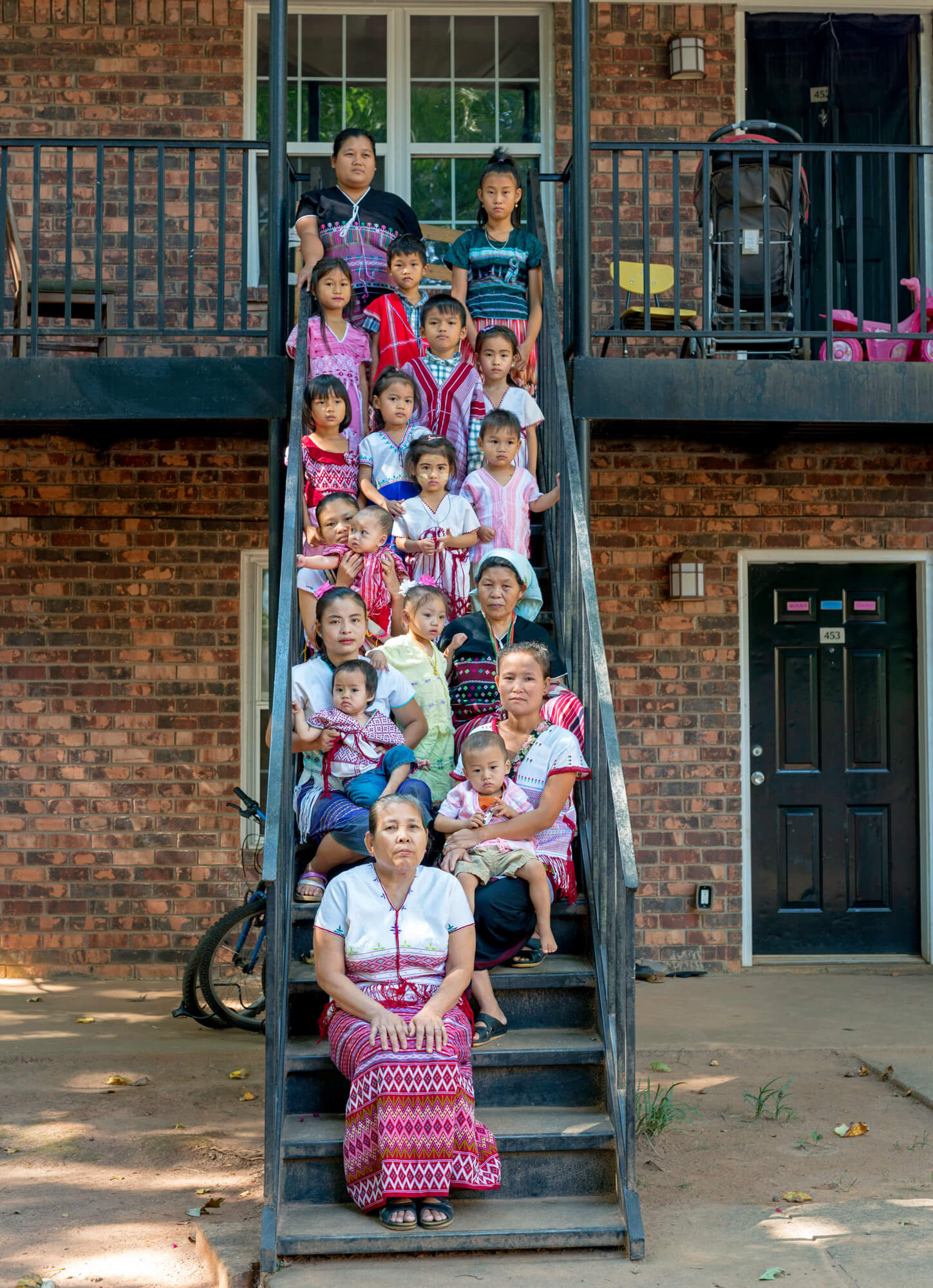 These four families — the Way Htoos, the Law Wahs, the April Paws, and the Mu Shis — are refugees who fled violence from their homes in Burma. They now live in Clarkston.
