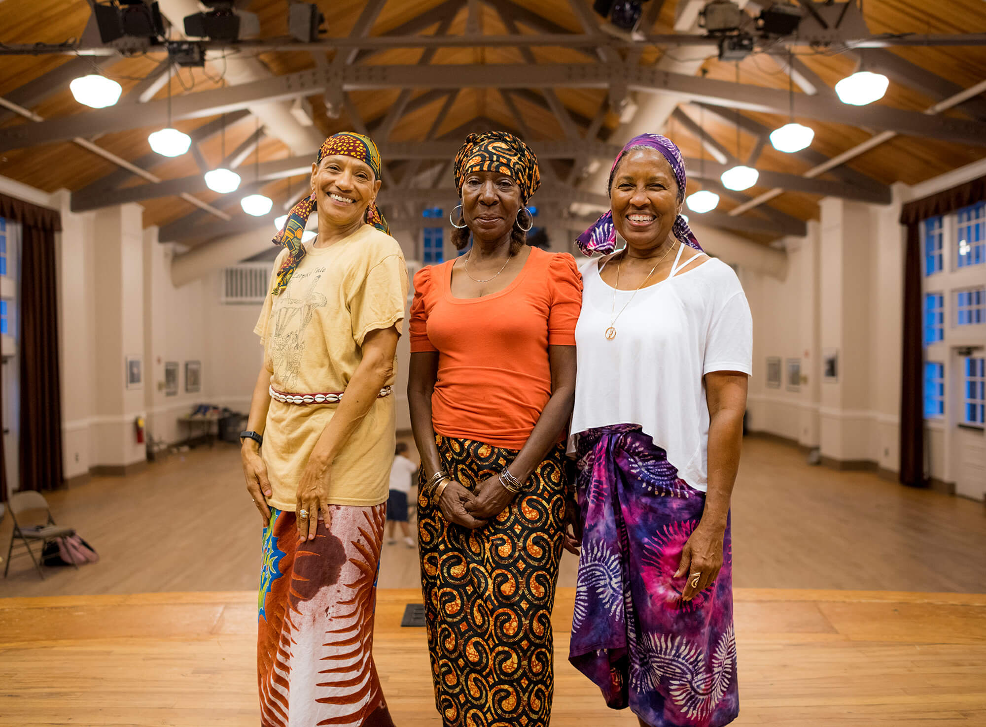 The Uhuru African Dancers pose for a portrait during rehearsal at the Clarkston Community Center. Uhuru is the longest-running African dance company in the Atlanta area.