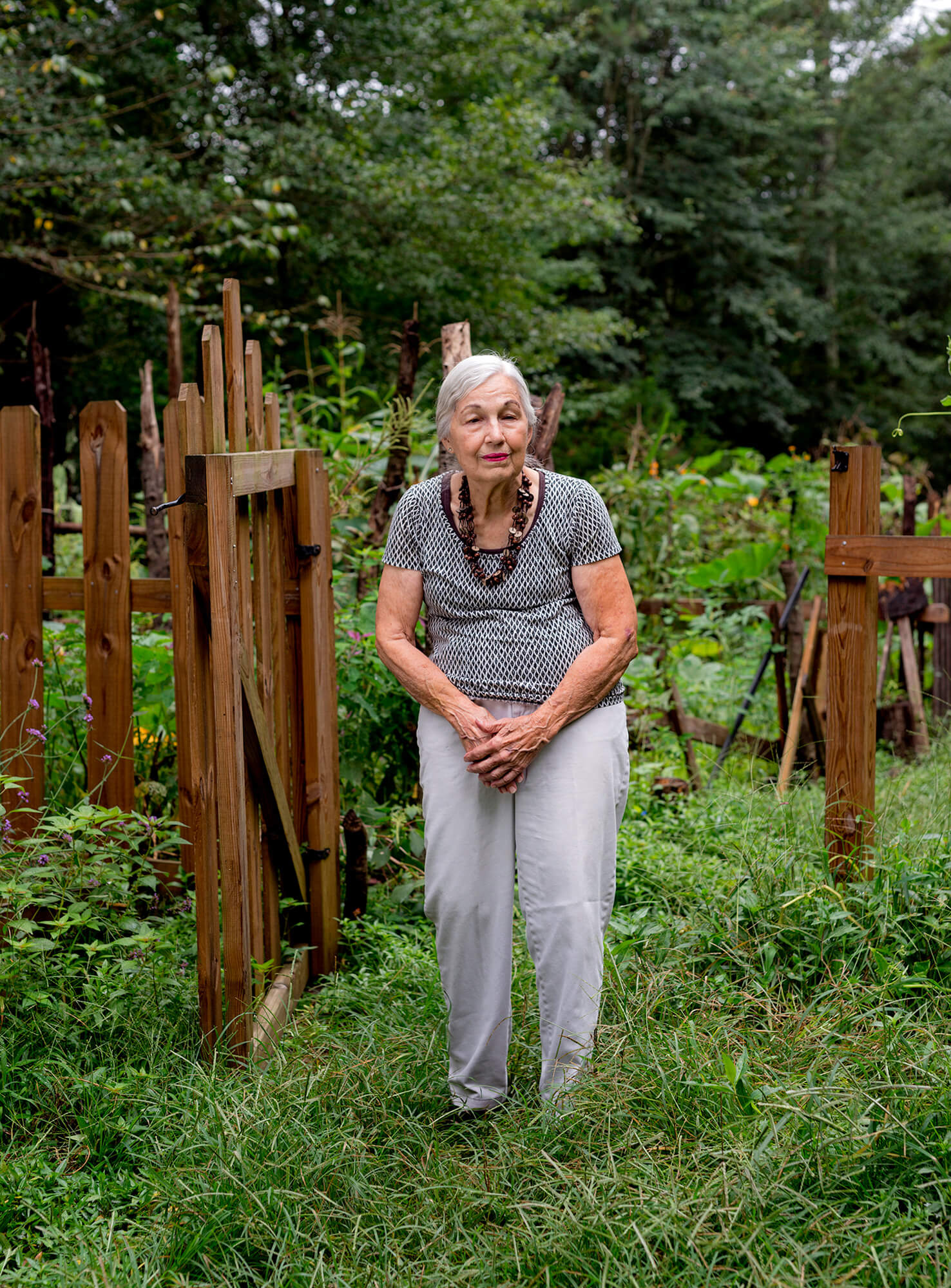 """Friends of Refugees Founder Pat Maddox — aka """"St. Pat of Clarkistan"""" —at the Forty Oaks Nature Preserve, just next to her property in Clarkston."""
