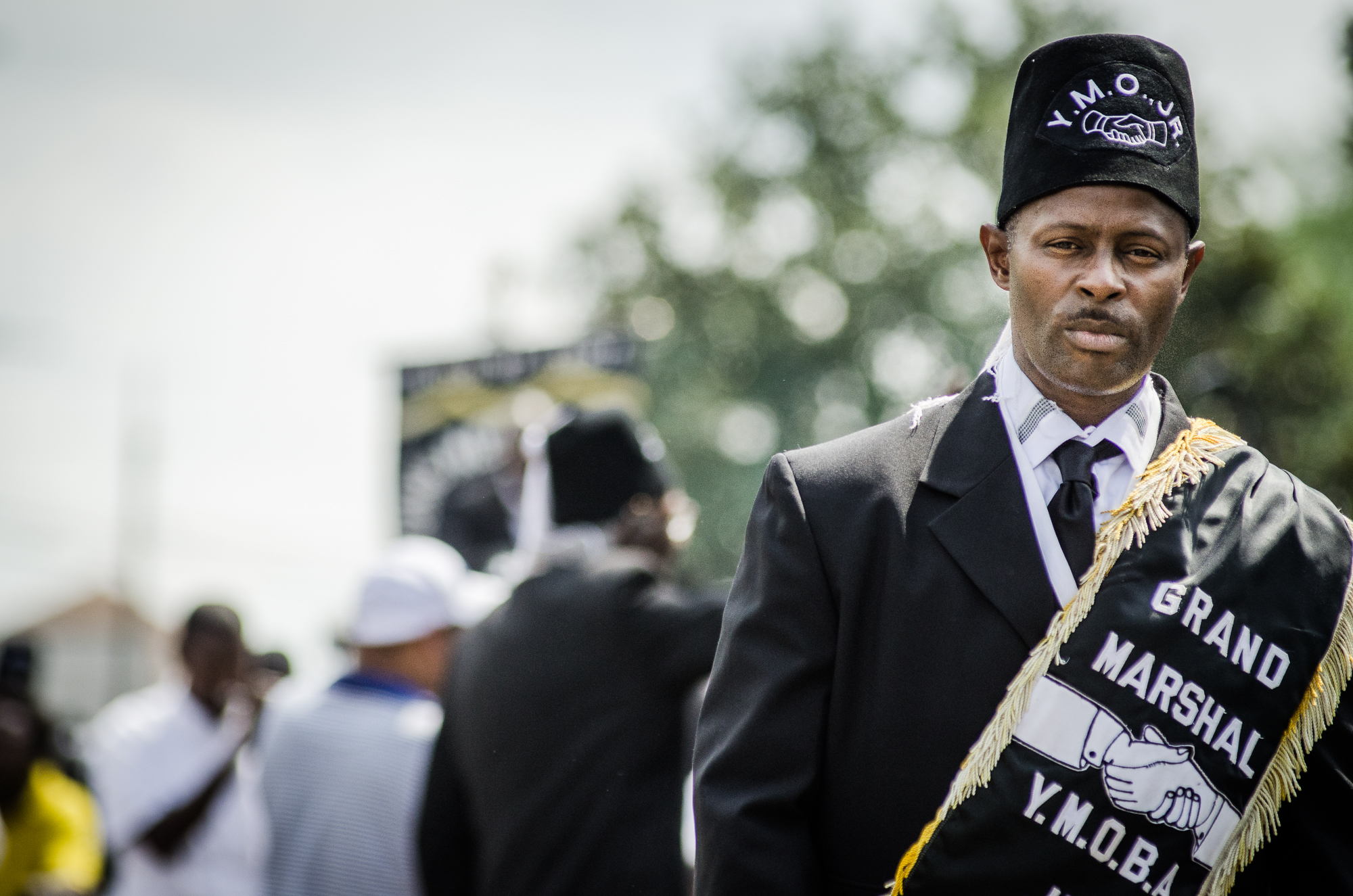 """Jerome Temple (DJ Jubilee) at the Funeral second line for Alfred """"Bucket"""" Carter, 2015"""
